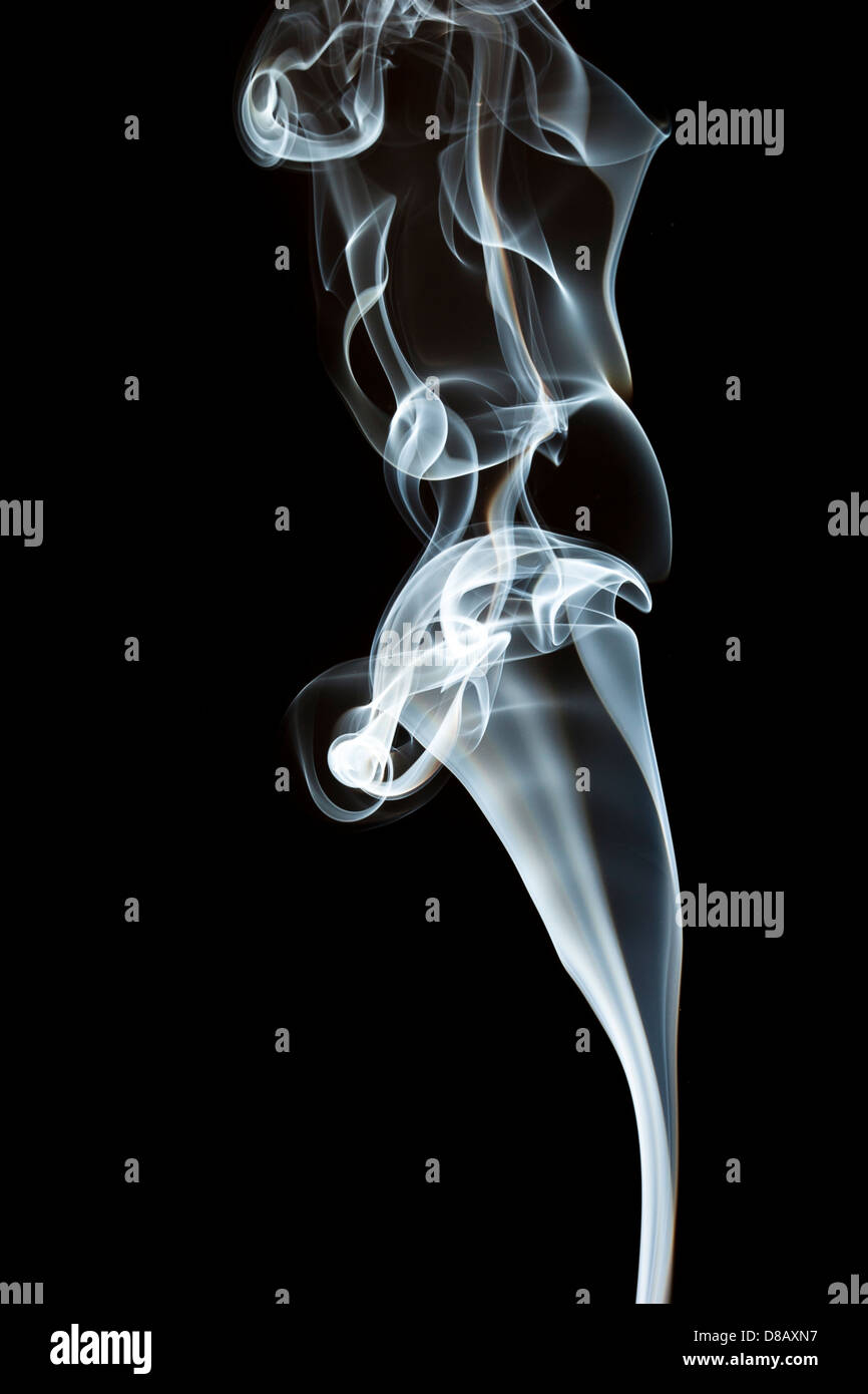 Whispy White Smoke against a black background Stock Photo