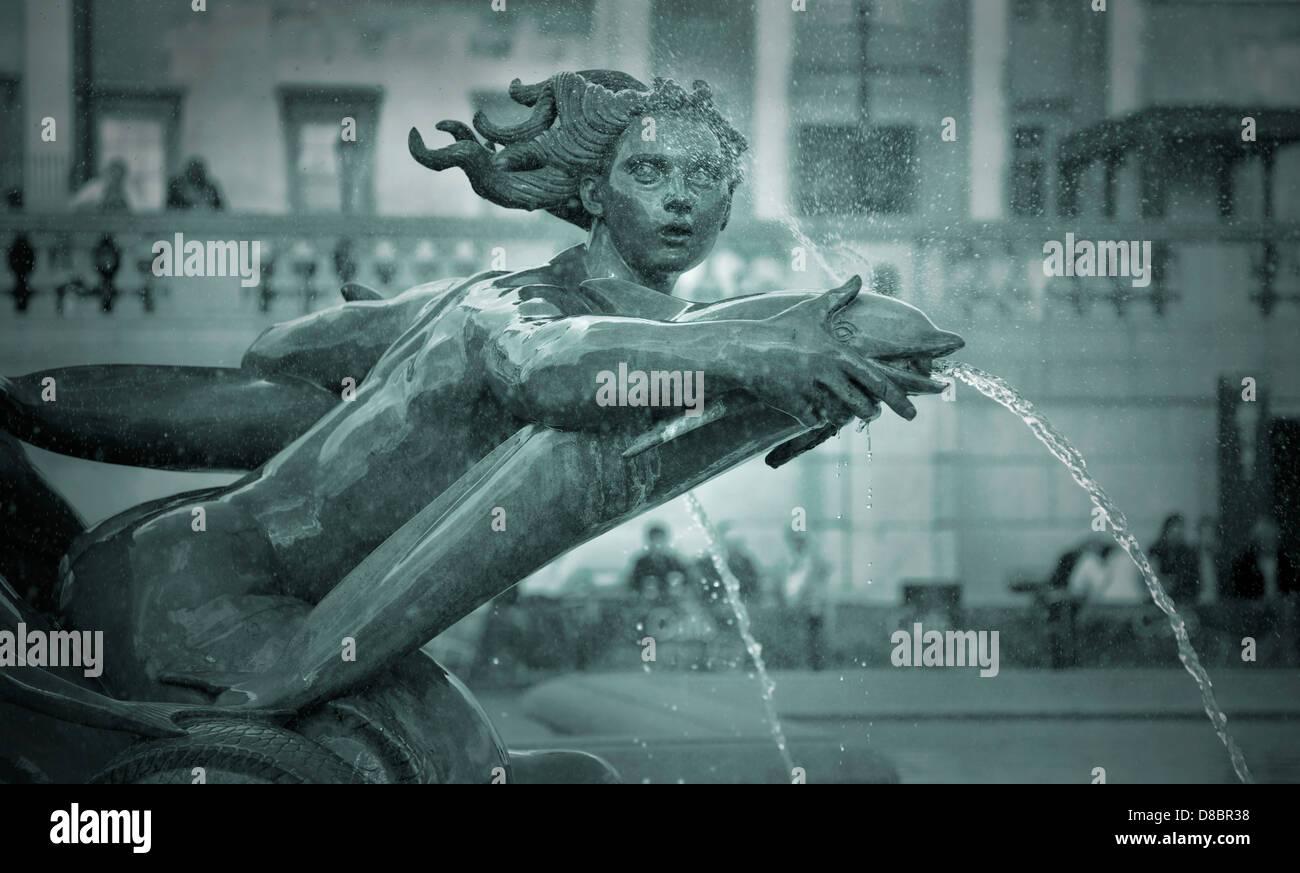 A detail of the mermaid fountain in Trafalgar Square, London, UK. - Stock Image
