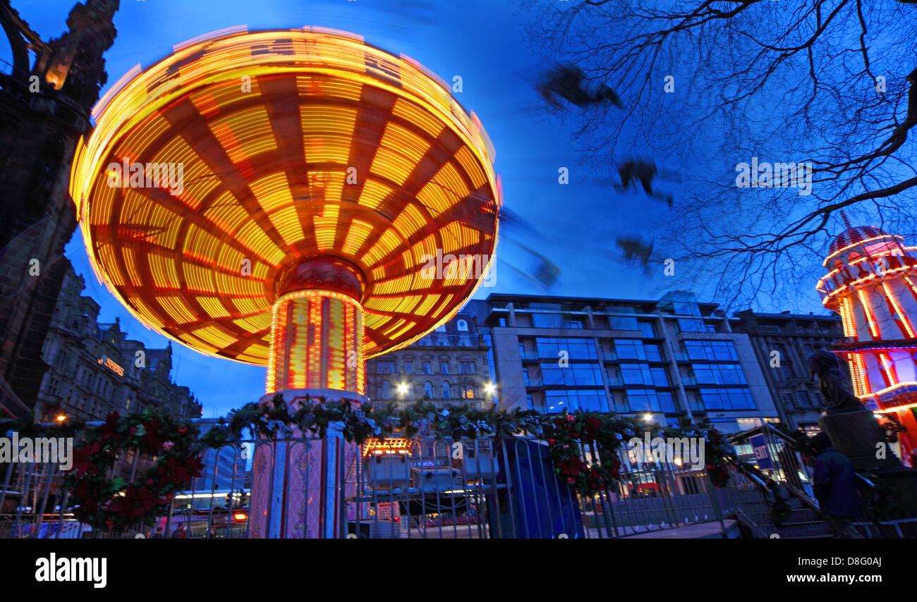 United,Kingdom,Edinburgh,City,Scotland,UK,dusk,movement,people,xmas,Christmas,blue,fun,Carousel,Scottish,British,GB,great,scots,merry-go-round,merrygo,merry-go,seats,tree,trees,funland,fun,excitement,Gotonysmith,Buy Pictures of,Buy Images Of