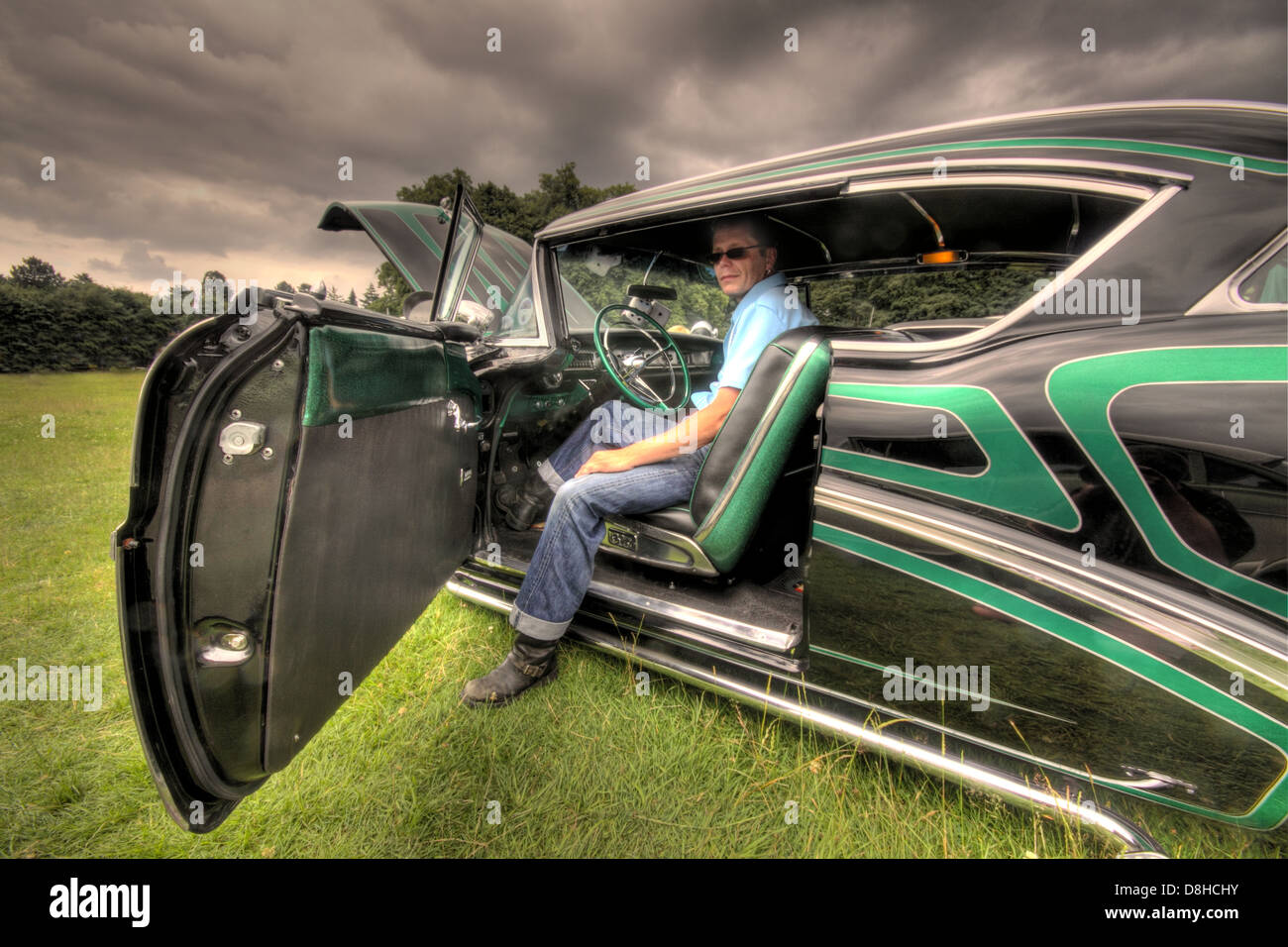 and,automobile,coche,cars,automobiles,old,57,Weatherby,with,his,award,winning,American,1957,classic,car,Kutsford,tatton,park,NT,property,Cheshire,England,UK,united,Kingdom,GB,great,Britain,American,U.S.,man,at,the,wheel,steering,hot,rod,hotrod,owner,hobby,interest,passion,vehicle,vehicles,show,gotonysmith,Buick,division,of,General,Motors,roadmaster,Cadillac,and,after 1940,senior,Oldsmobiles,cars,Special,Riviera,coupe,sedan,Buy Pictures of,Buy Images Of