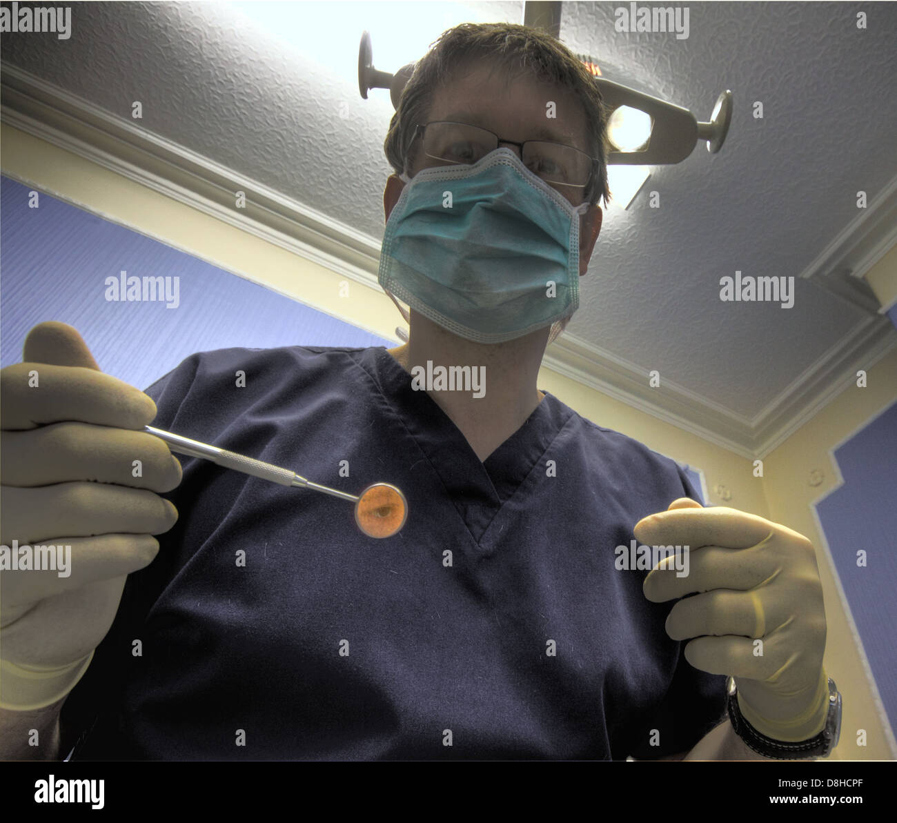 surgeon,mask,light,lighting,gloves,rubber,fear,psychological,afraid,in,the,chair,England,English,Warrington,GB,British,great,britain,dental,operate,operating,portrait,man,male,cover,insurance,insure,cosmetic,general,training,school,dentures,exam,restorations,crowns,bridges,in,a,reflection,room,oral,gotonysmith,services,NHS,schools,degree,degrees,exams,light,lighting,implant,placemen,reflect,qualification,General,anesthesia,and,maxillofacial,surgery,and,implants,gum,gums,teeth,tooth,extract,extraction,Buy Pictures of,Buy Images Of