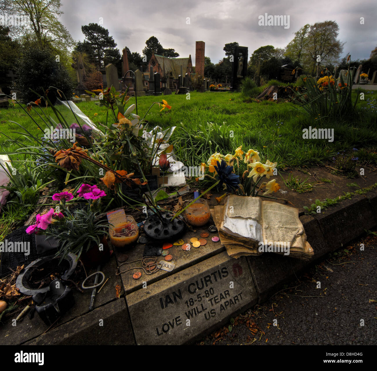 Macclesfield,Cemetary,IanCurtis,singer,vocalist,of,Manchester,Joy,Division,Rock,Band,died,18-5-80,inscription,flower,tribute,tributes,JD,18/05/1980,1980,May,18,18th,new,wave,england,english,NW,Factory,records,died,death,suicide,control,film,movie,Kevin,act,tomb,tombstone,musician,dead,musicians,gotonysmith,flowers,sombre,record,tony,wilson,New,order,neworder,ideal,for,living,EP,Atmosphere,24,hour,24hour,party,people,Bernard,Sumner,and,Peter,Hook,label,epileptic,seizures,famous,deceased,urban,decay,tourist,tourism,things,to,see,in,Martin,Hannett,Debbie,shrine,place,of,pilgrimage,Anton,Corbijn,Buy Pictures of,Buy Images Of