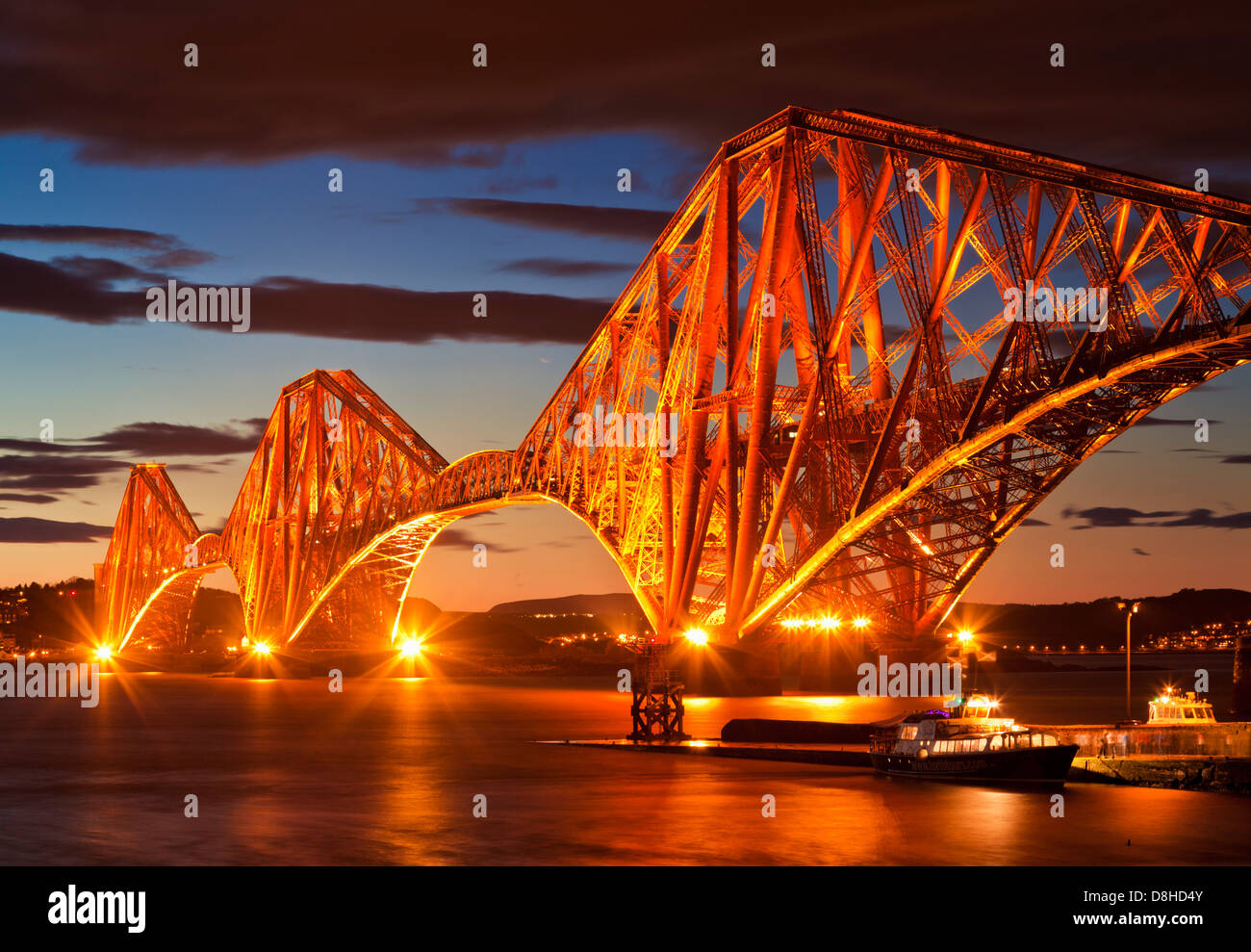 Forth rail bridge illuminated at night South Queensferry Edinburgh Midlothian Scotland uk gb eu europe - Stock Image