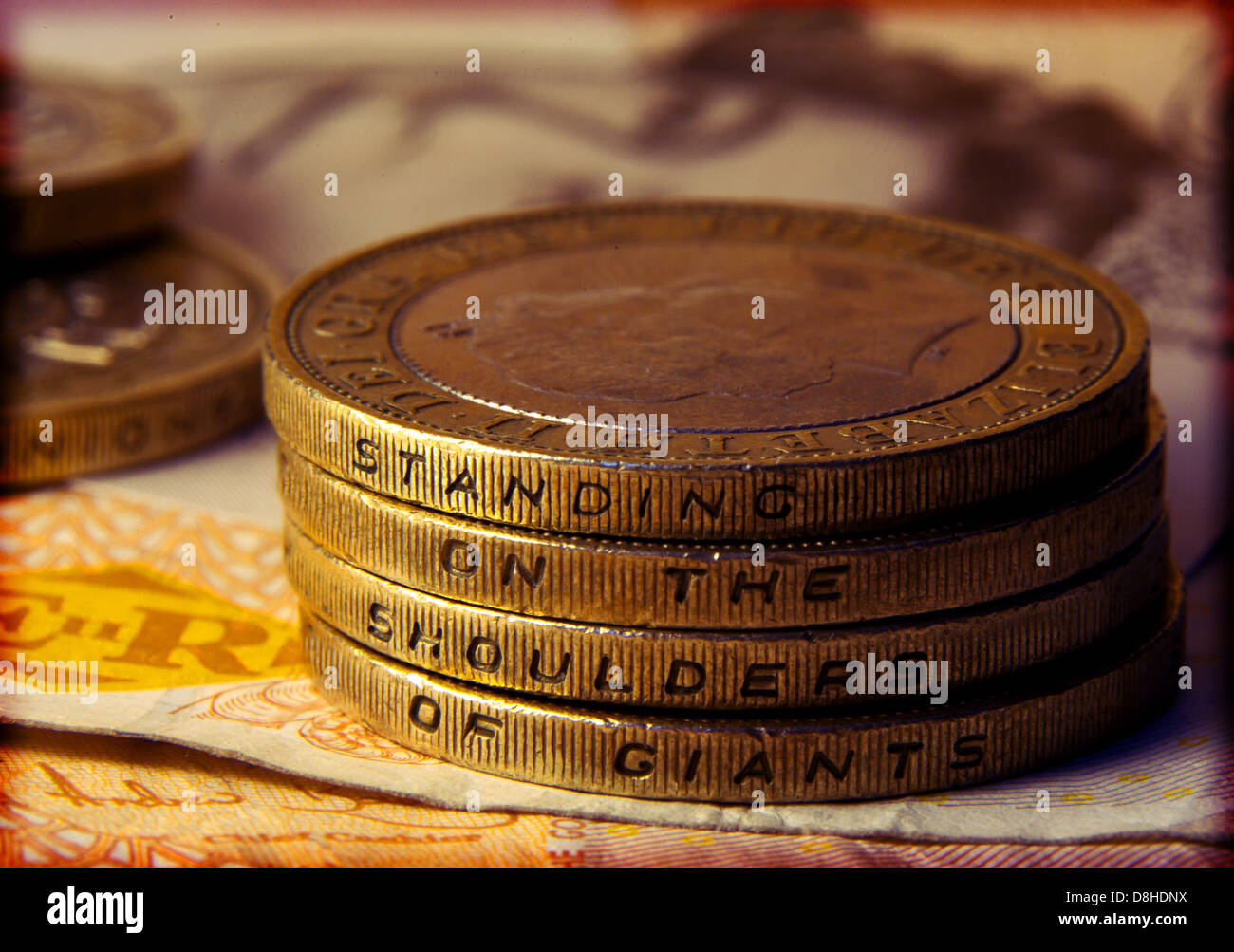 on,the,shoulder,of,giants,oasis,sterling,album,CD,title,brown,coins,fourth,studio,album,by,English,rock,band,Manchester,britain,2,quotation,of,Newton,four,coins,stacked,tower,on,10,pound,note,£,money,cash,loose,change,gotonysmith,Dwarfs,standing,on,the,shoulders,of,giants,Latin,nanos,gigantum,humeris,insidentes,is,a,Western,metaphor,with,a,contemporary,interpretation,meaning,Buy,Pictures,of,Buy,Images,Of,Its,most,familiar,expression,is,found,in,the,letters,of,Isaac,Newton,one,who,discovers,by,building,on,previous,discoveries,,,