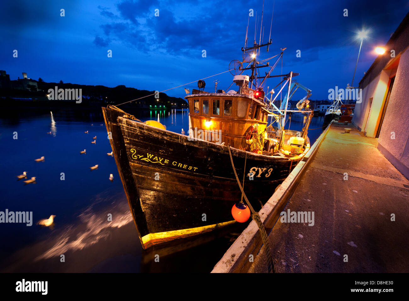 Wave,Crest,Trawler,docked,at,Stornoway,Fishing,Port,&,Harbour,at,dusk,SY3,night,shot,nightshot,sea,gulls,seagulls,feeding,on,waste,fish,thrown,back,HHP,CNES,historic,outer,hebrides,hebridean,hebridan,Western,Isles,fishing,industry,fisheries,fishermen,boat,boats,evening,dramatic,gotonysmith,mixed,lighting,tripod,blue,hour,bluehour,sky,Lewis,castle,town,capital,Scotland,scottish,islands,ferry,tours,tourism,product,products,culture,gaelic,language,EU,Fishing,quota,Brexit,freedom,British,waters,territory,territorial,rights,borders,border,sovereignty,iconic,Alba,Celtic,@HotpixUK,HotpixUK,tour,tourist,attraction,travel,fish,harbour,maritime,Steòrnabhagh,Na h-Eileanan Siar,Western Isles,Leòdhas,Eilean,CNES,Alba,Buy Pictures of,Buy Images Of,territorial waters,Scotlands History,Scotlands History,Eilean Leòdhais,Stornoway town