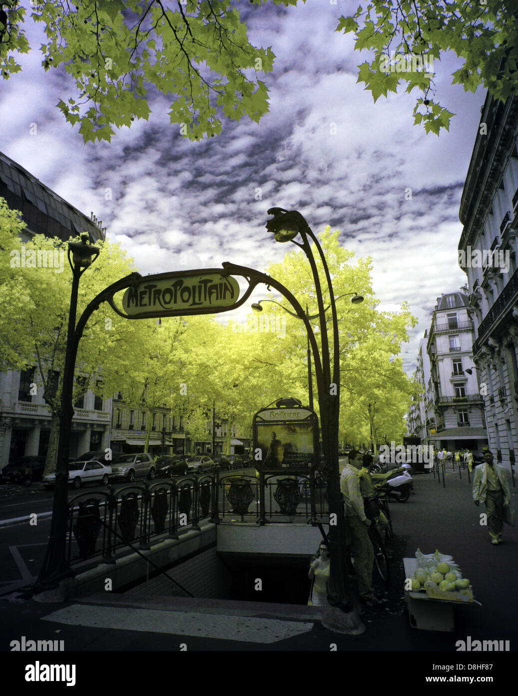 An,Art,Nouveau,Paris,metro,station,entrance,taken,with,an,IR,Infra-Red,adapted,Canon,5D,camera,DSLR,France,Europe,french,capital,unusual,gotonysmith,Guimard,entrances,tube,mass,transit,720nm,infrared,cast-iron,balustrade,decorated,in,plant-like,motifs,accompanied,by,a,Métropolitain,sign,supported,cast,iron,two,orange,globes,atop,ornate,cast-iron,supports,in,the,form,of,plant,stems,Metropolitan,Metropolitain,gotonysmith,Buy Pictures of,Buy Images Of