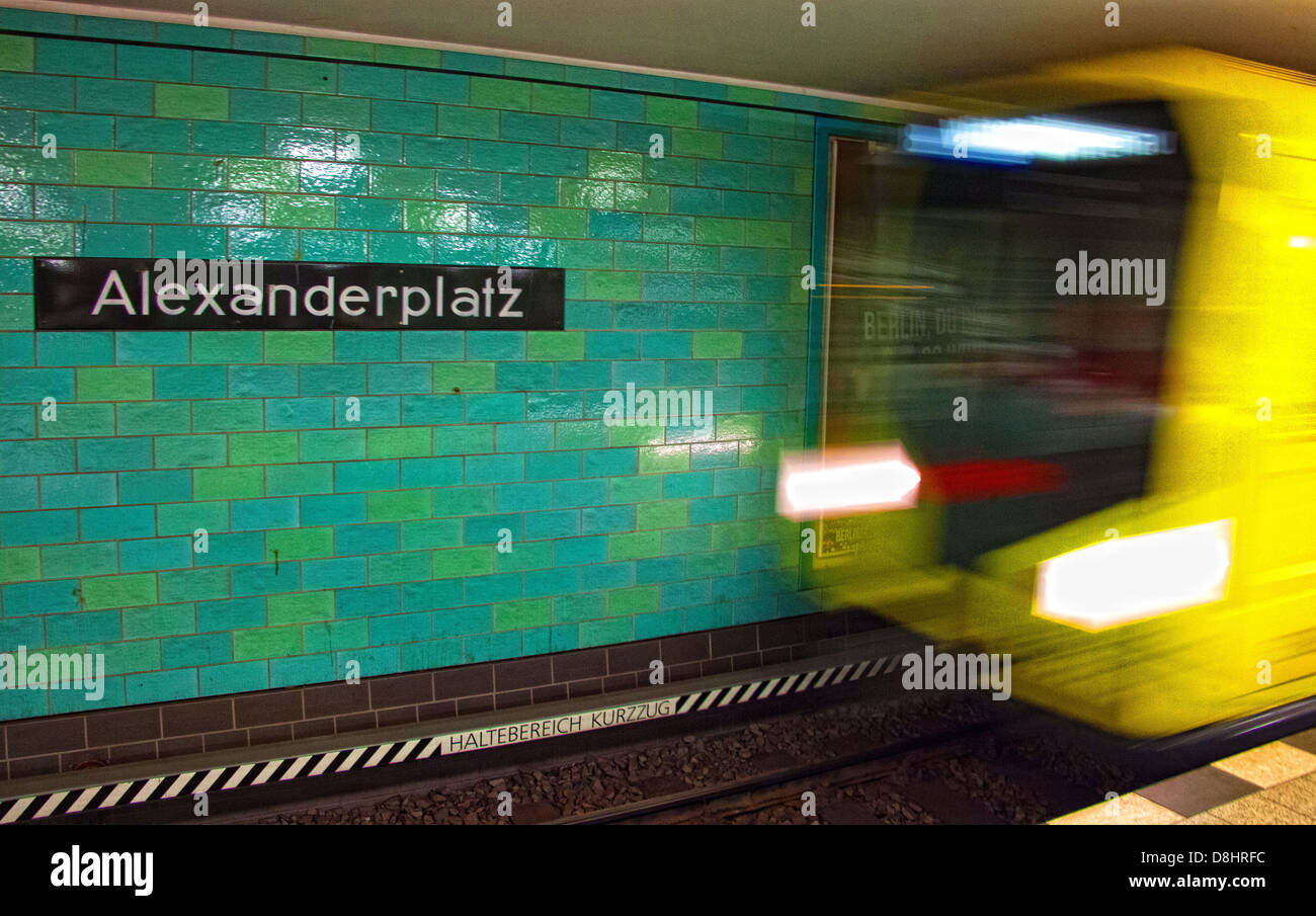 Metro,train,arrives,at,Berlin,Alexanderplatz,UBahn,Station,departs,blur,underground,metro,yellow,rushing,movement,green,tiles,gotonysmith,shopping,centre,square,platz,central,city,interchange,blurring,famous,spy,spies,Mitte,district,central,location,site,where,tourists,regularly,change,Regional-Express,and,Regionalbahn,lines,S-Bahn,rapid,transit,lines,S5,S7,and,S75,call,at,the,overground,largest,on,the,Berlin,U,Bahn,network,with,the,lines,U2,U5,and,U8,calling,tram,lines,Buy Pictures of,Buy Images Of