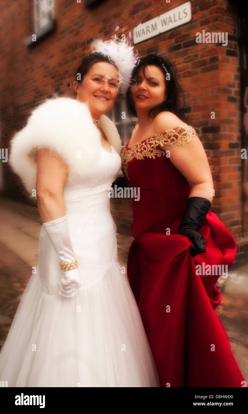 Two ladies by Warm Walls an old bakehouse in Sandbach,south,Cheshire,white,red,dress,wedding,beautiful,attractive,woman,girl,lady,ladies,gotonysmith,dresses,agency,sexy,fun,England,UK,united,Kingdom,GB,Great,Britain,gotonysmith,Buy Pictures of,Buy Images Of
