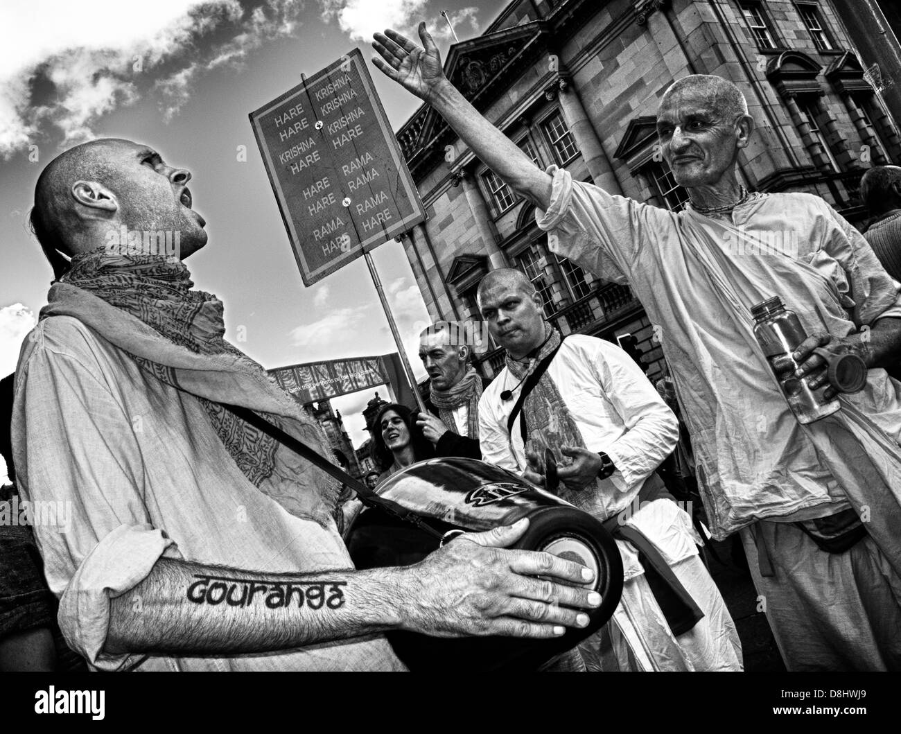 Krishnas,mono,monochrome,B/W,Black,White,sing,singing,in,the,street,making,people,ppl,High,St,Edinburgh,Scotland,August,festival,time,message,of,love,shaved,head,heads,capital,city,cities,tat,tattoo,gotonysmith,gotonysmith,Buy Pictures of,Buy Images Of