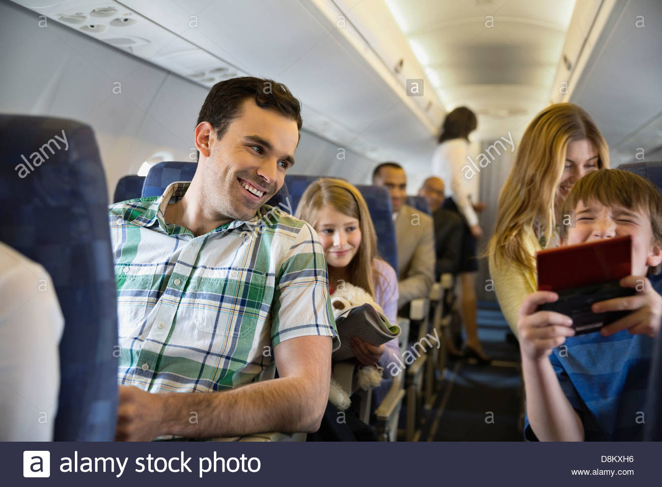 Passengers traveling in airplane - Stock Image