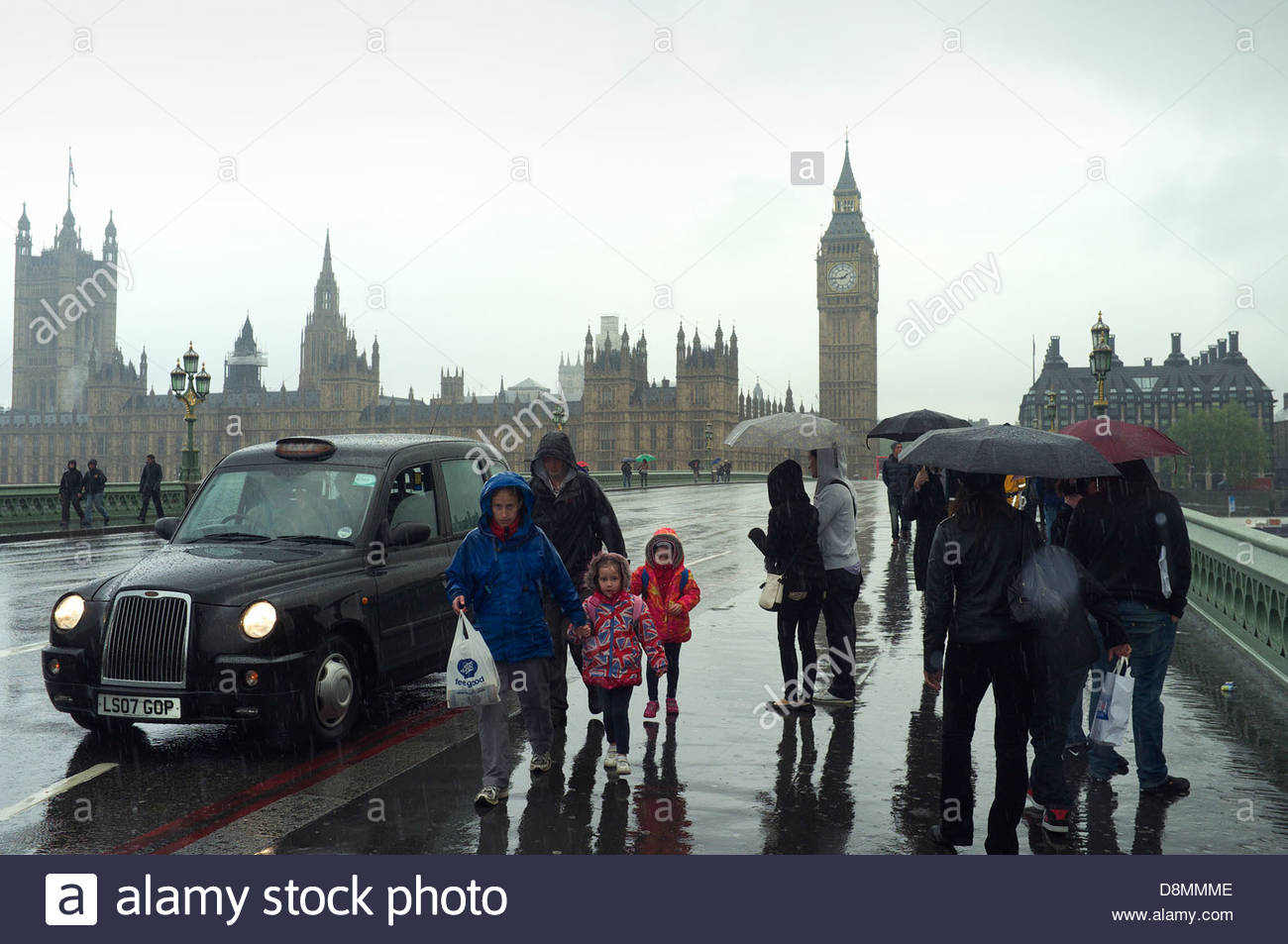 A rainy day in London, with the Houses of Parliament in the background. London, UK. Stock Photo