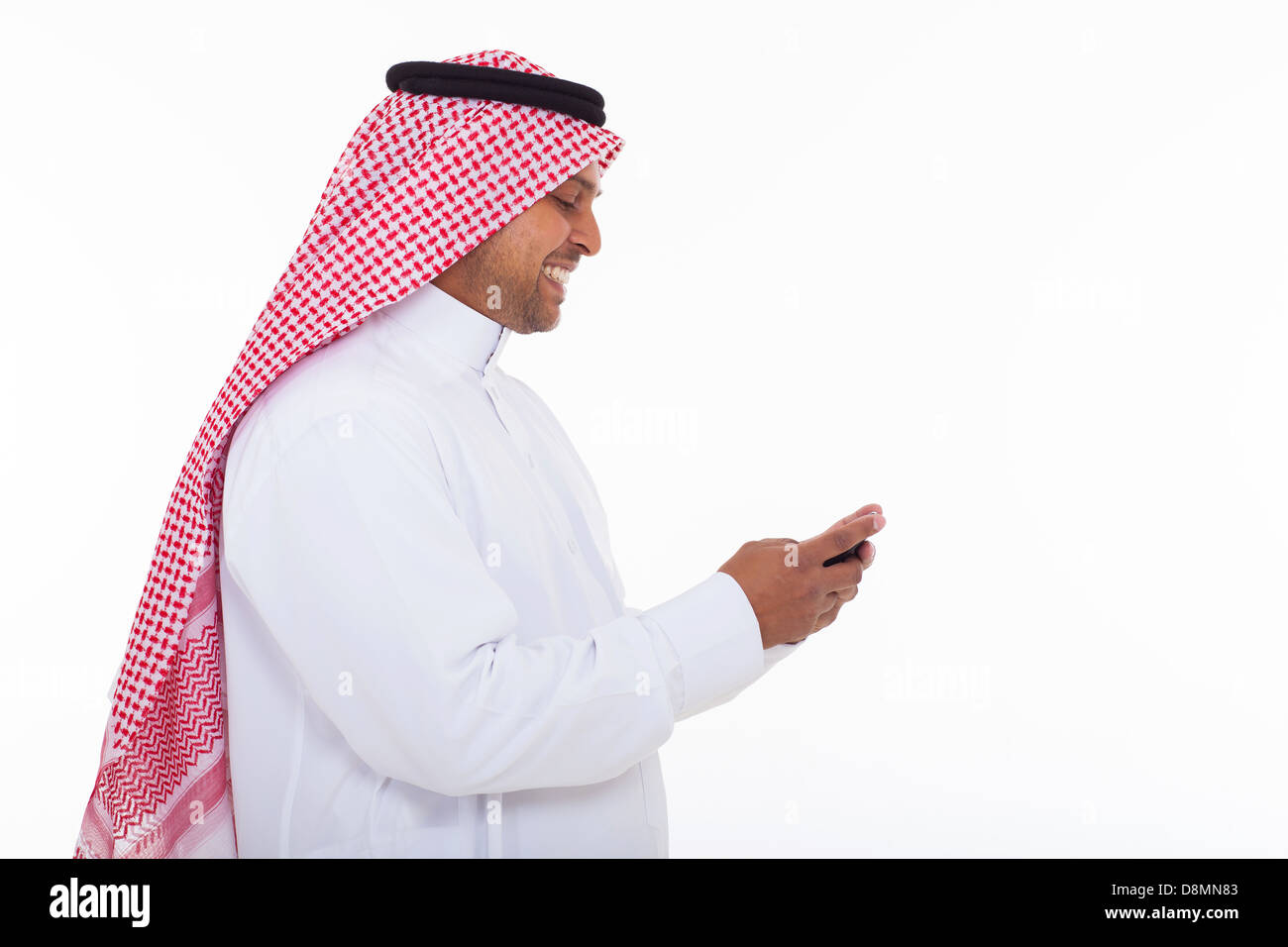 Side View Of Cheerful Muslim Man In Traditional Clothes Using Cell