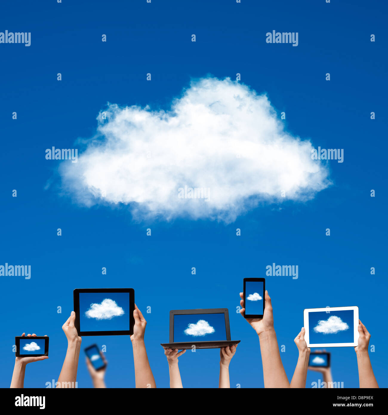 cloud computing concept. hands holding computer laptop smart phone tablet and touch pad - Stock Image