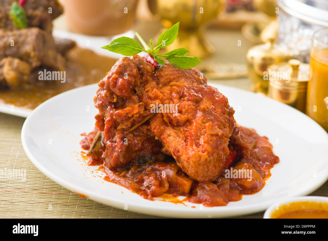 curry chicken rendang cooked in indian style with spicy sauce and chilli Stock Photo