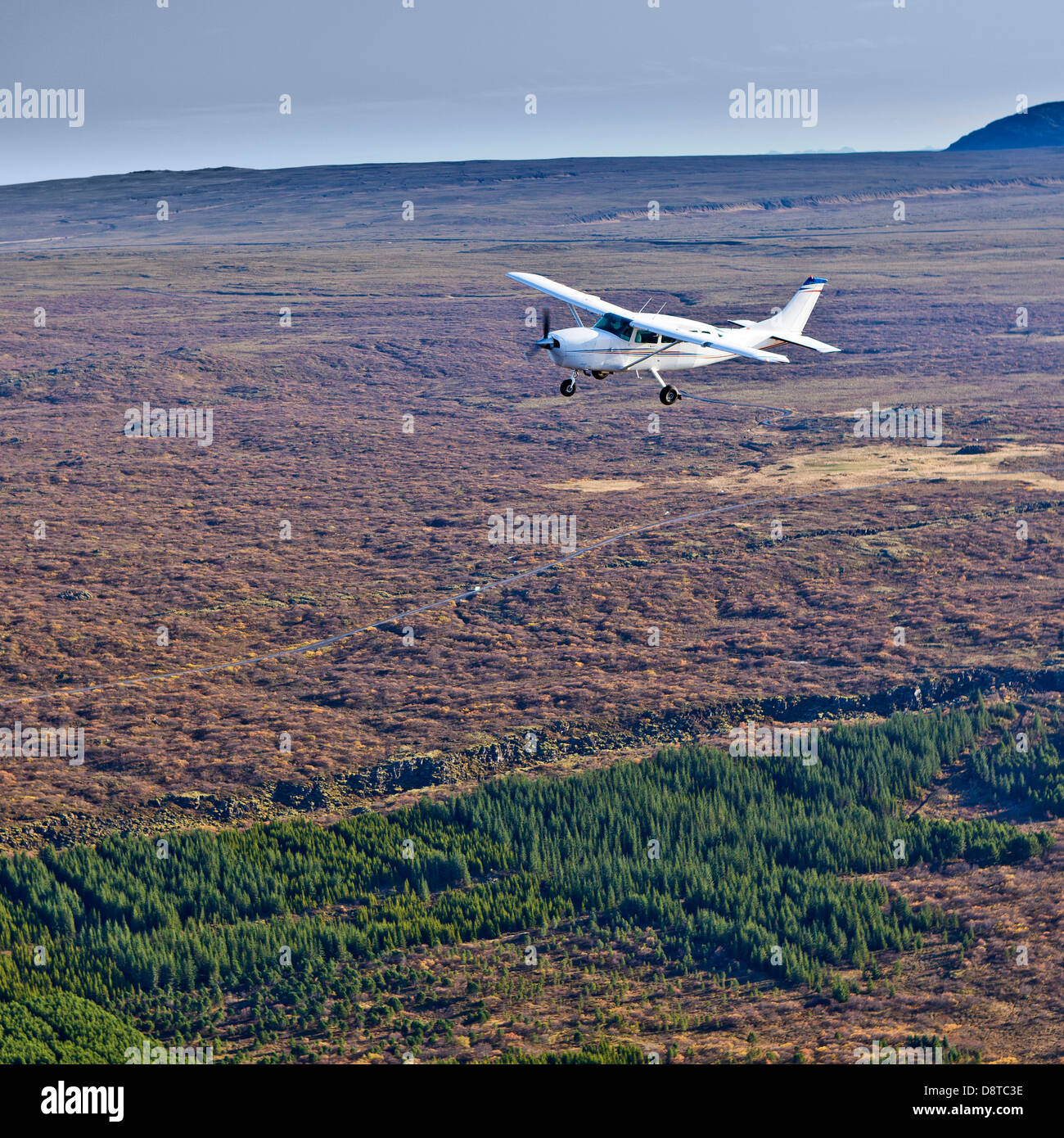 Cessna flying over South Coast in Iceland - Stock Image