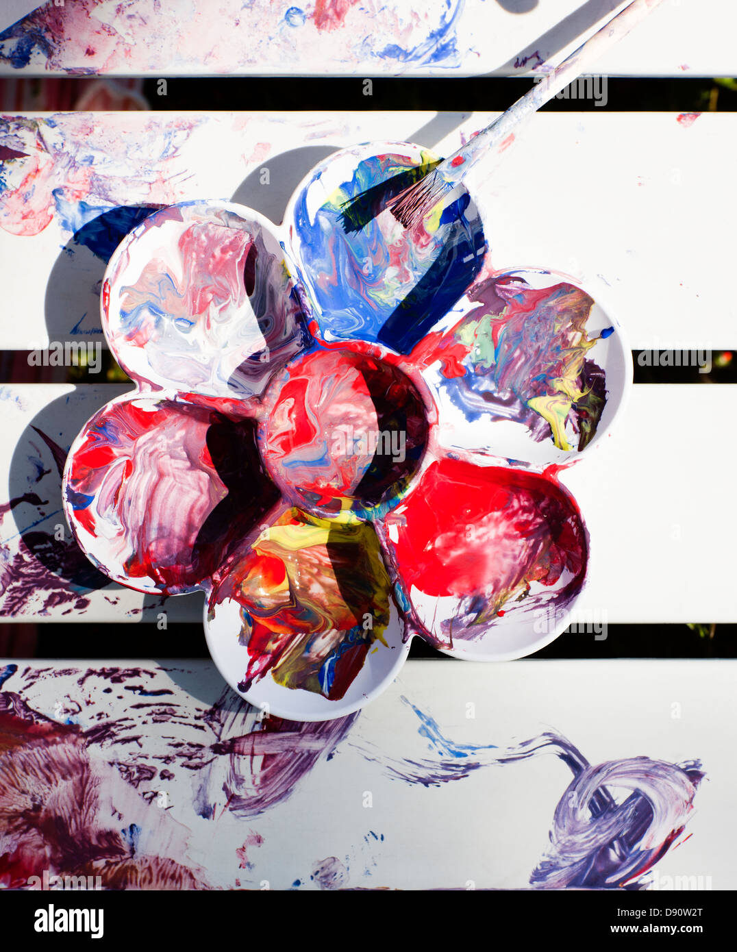 Close up of palette with colorful paints - Stock Image