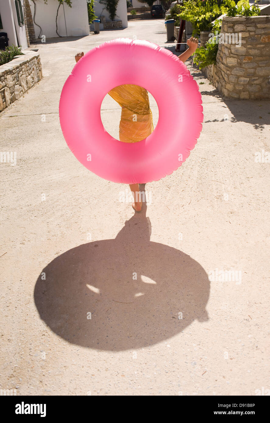 A girl carrying a bathing ring, Greece Stock Photo: 57193830 - Alamy