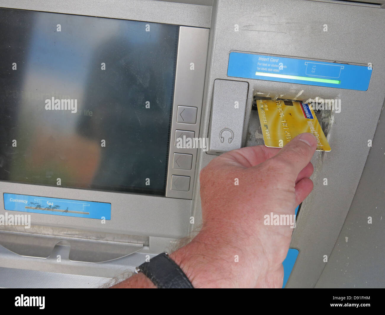 Putting,a,Nationwide,account,card,into,a,co-op,cash,machine,yellow,gotonysmith,England,UK,United,Kingdom,push,pushing,chip,and,pin,hand,finger,ATM,cashmachine,Magnetic,strip,plastic,plasticcard,creditcard,credit,debit,gotonysmith,Buy Pictures of,Buy Images Of
