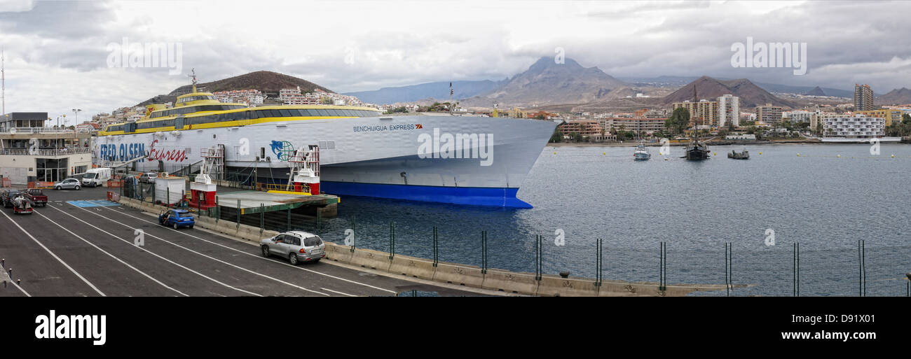 Ferry,port,at,Los,Cristianos,town,Southern,Tenerife,Canary,Islands,Spain,island,islandsferries,loading,trucks,truck,goods,gotonysmith,queue,queuing,spanish,fredolsen,sea,links,boat,services,Naviera,Arnas,transport,coach,bus,coaches,cruise,trimaran,fast,ferries,travel,ticket,dock,hills,volcano,gotonysmith,Buy Pictures of,Buy Images Of