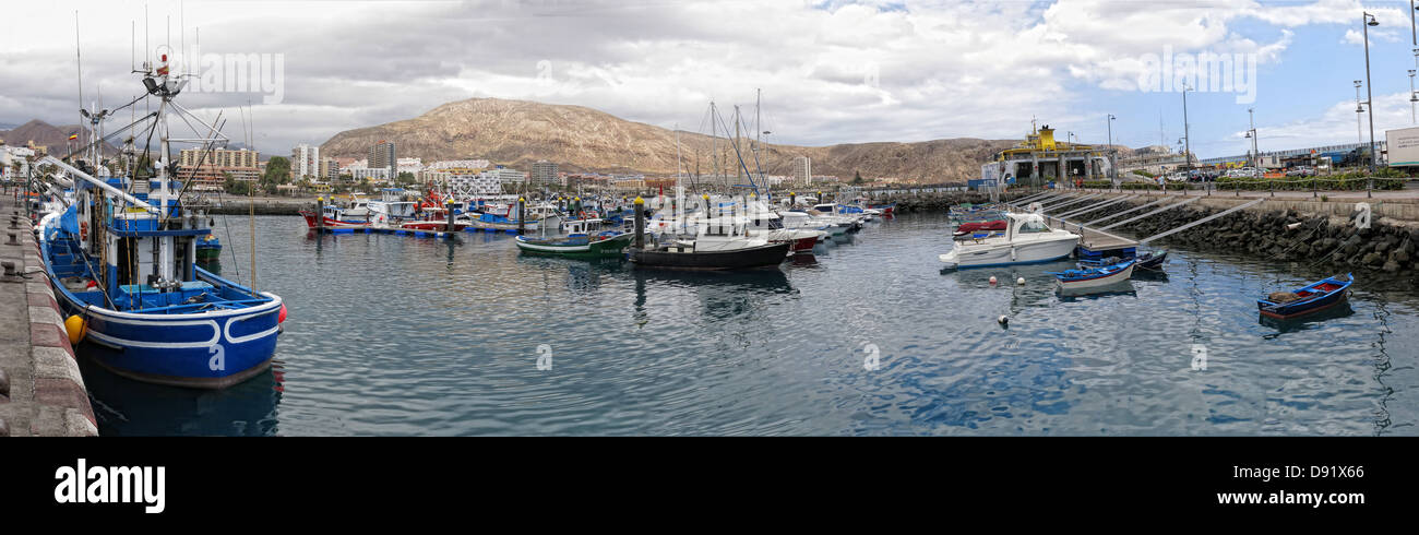 Harbour,/,Harbor,panorama,at,Los,Cristianos,town,Southern,Tenerife,Canary,Islands,Spain,wide,fishing,boats,charters,boat,trawler,trawlers,working,fishing,fisherman,fisher,overcast,sea,safe,dock,gotonysmith,Espana,blue,hull,natural,pano,wide,shot,afternoon,calm,calming,island,tourist,destination,holiday,holiday,makers,popular,ferry,port,brochure,shot,travel,Buy Pictures of,Buy Images Of