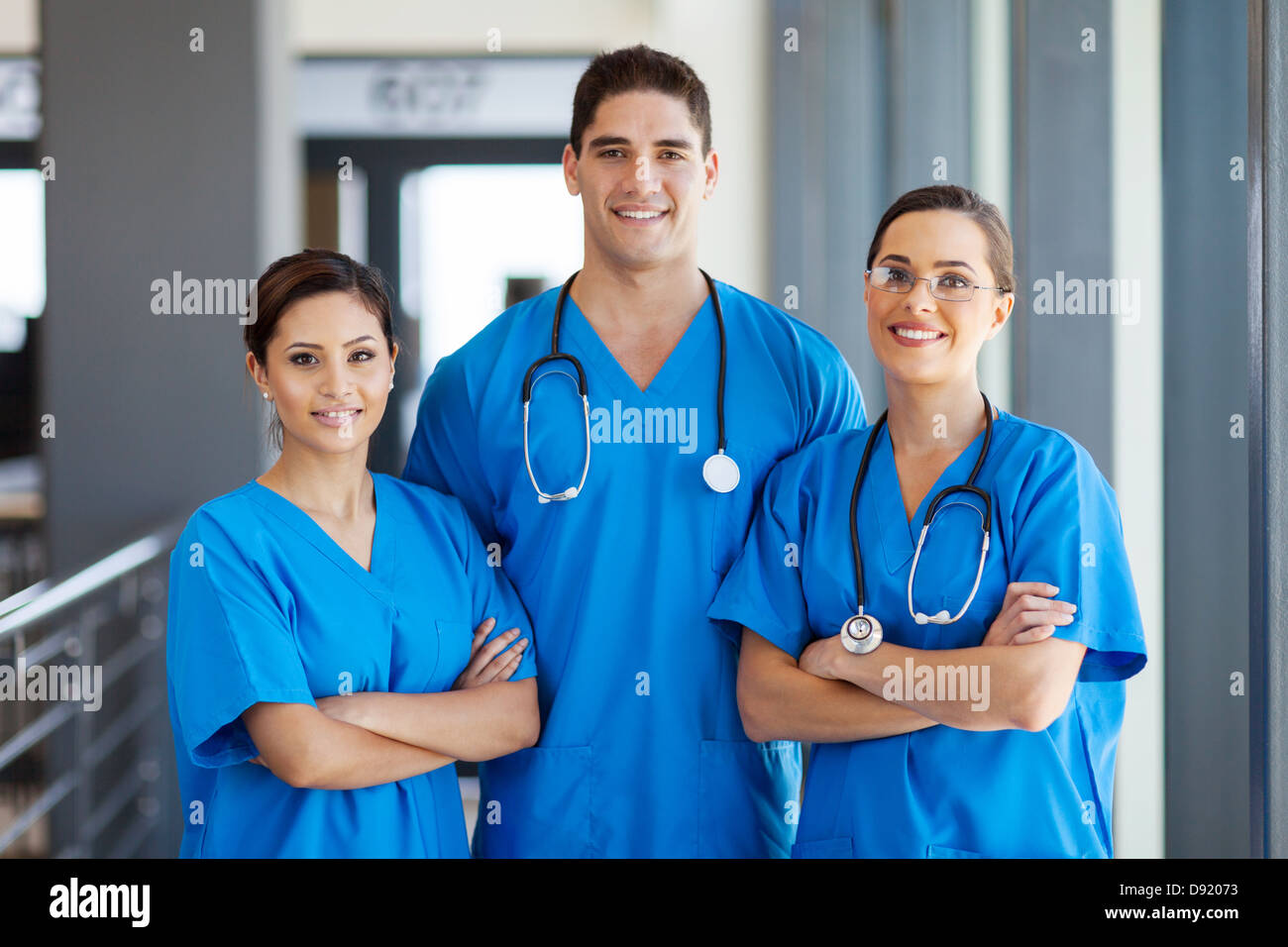 group of young hospital workers in scrubs - Stock Image