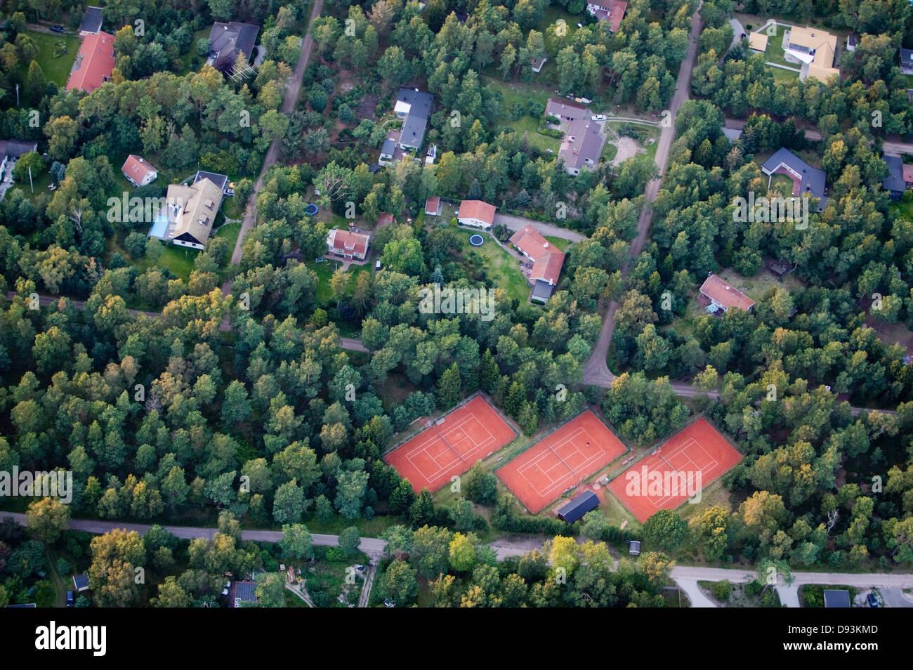 Residential district with tennis court Stock Photo