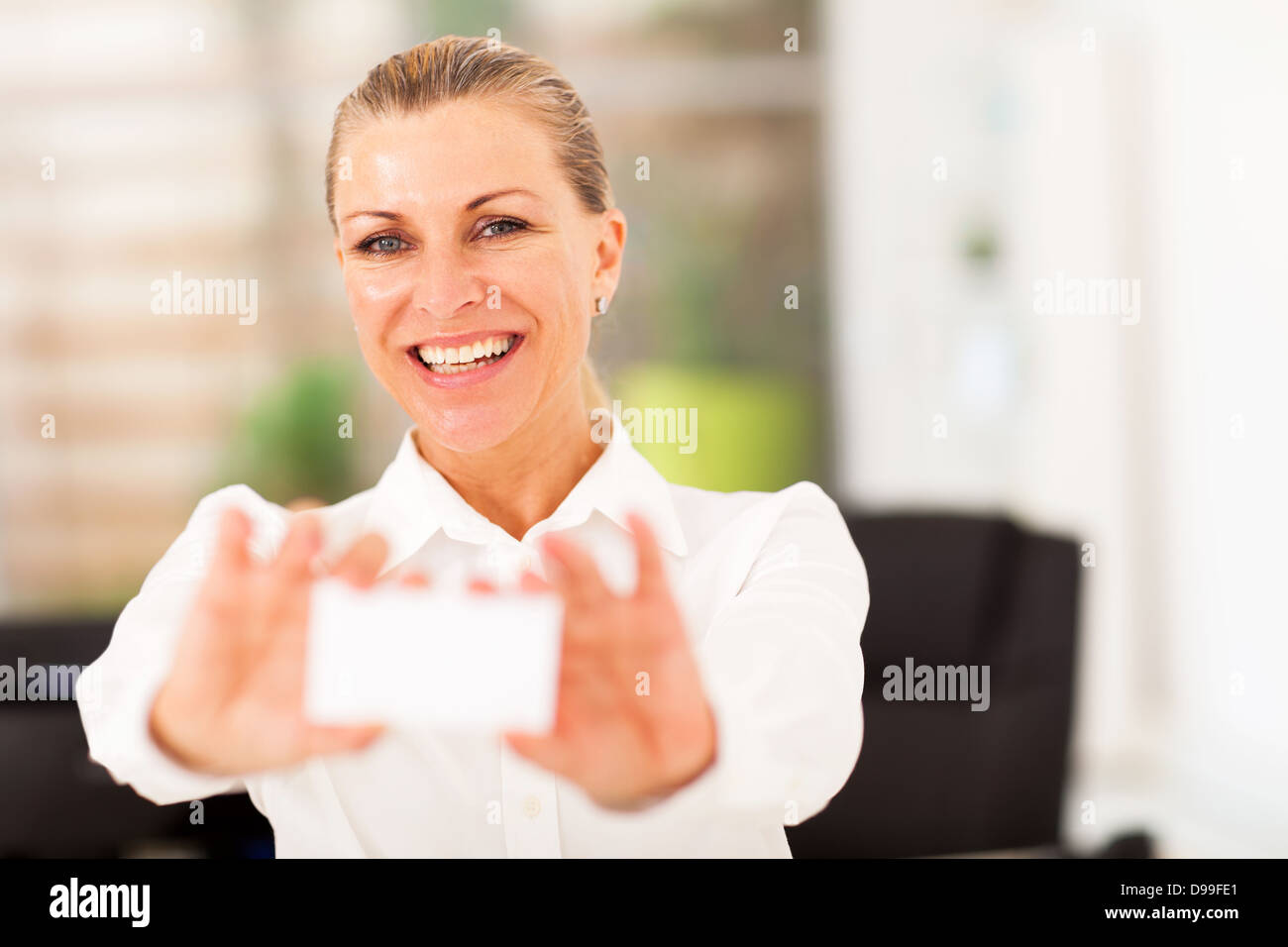Happy senior businesswoman holding business card stock photo happy senior businesswoman holding business card reheart Image collections