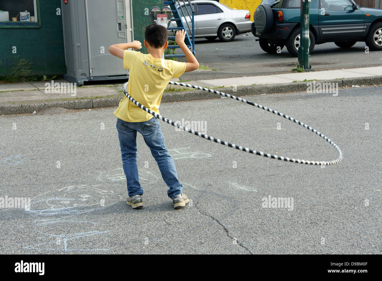 boy-twirling-a-large-hula-hoop-on-a-stre