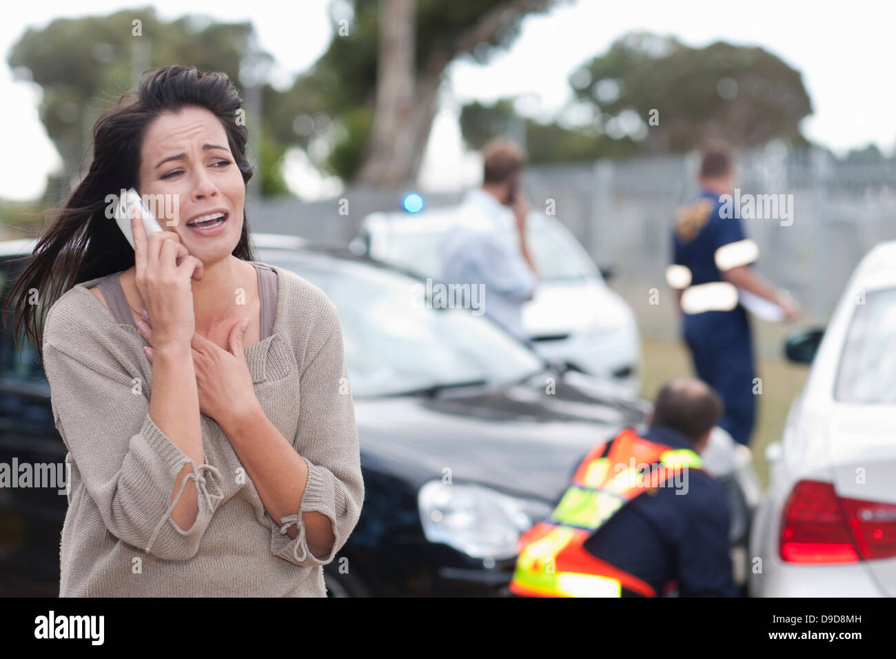 Woman crying after car accident - Stock Image