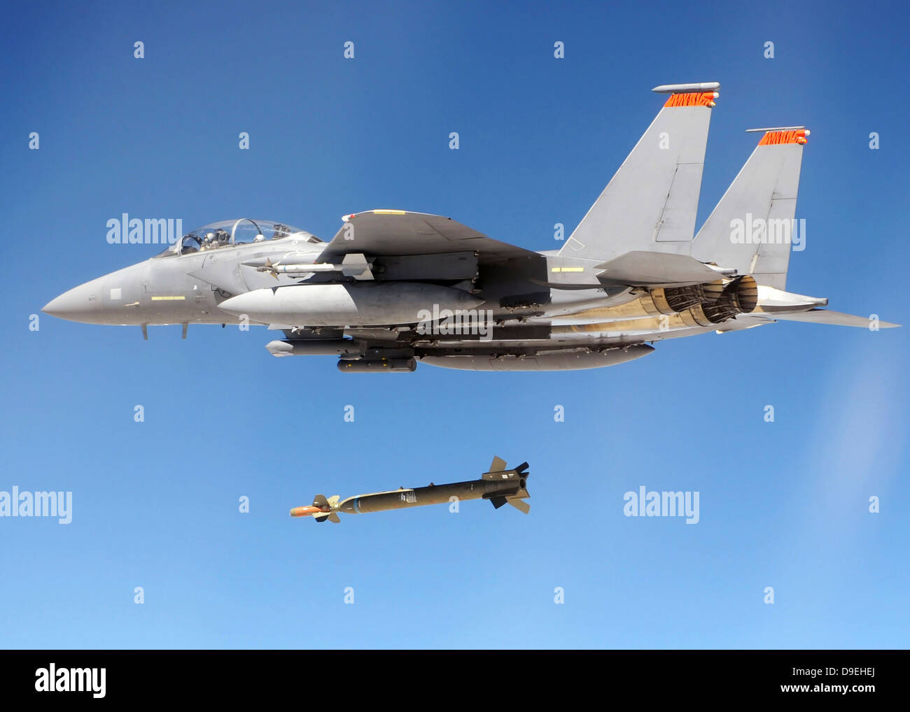 An F-15E Strike Eagle drops a GBU-28 bomb during a Combat Hammer mission - Stock Image
