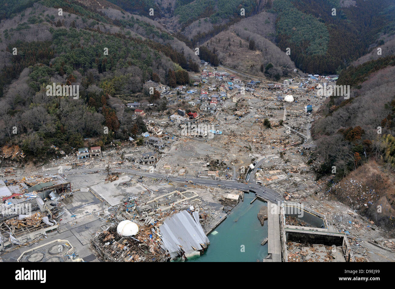 A helicopter team surveys the tsunami and earthquake damage over Japan. - Stock Image