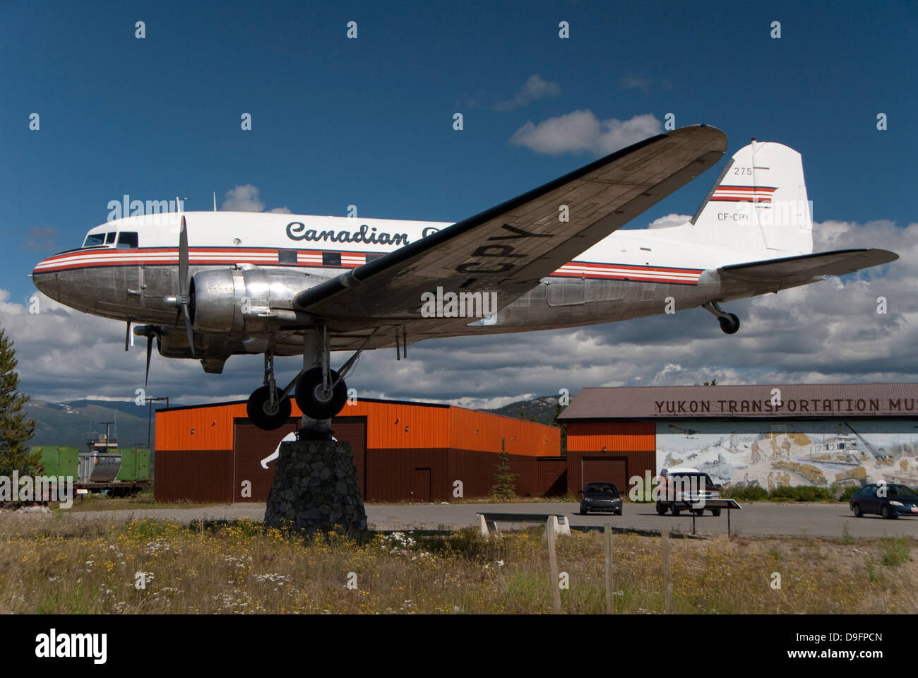 Airport, retired DC-3 aircraft atop a swivelling support, the world's largest weather vane, Whitehorse, Yukon, - Stock Image
