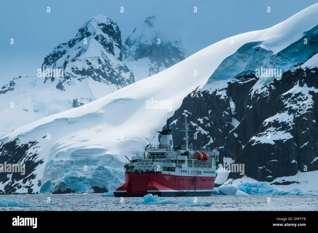 Cruise ship in front of the glaciers and icefields of Danco Island, Antarctica, Polar Regions - Stock Image