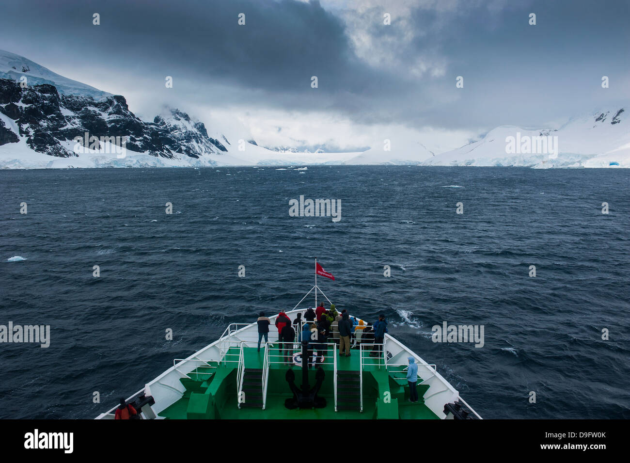 Dark clouds over the mountains and glaciers of Port Lockroy research station, Antarctica, Polar Regions - Stock Image
