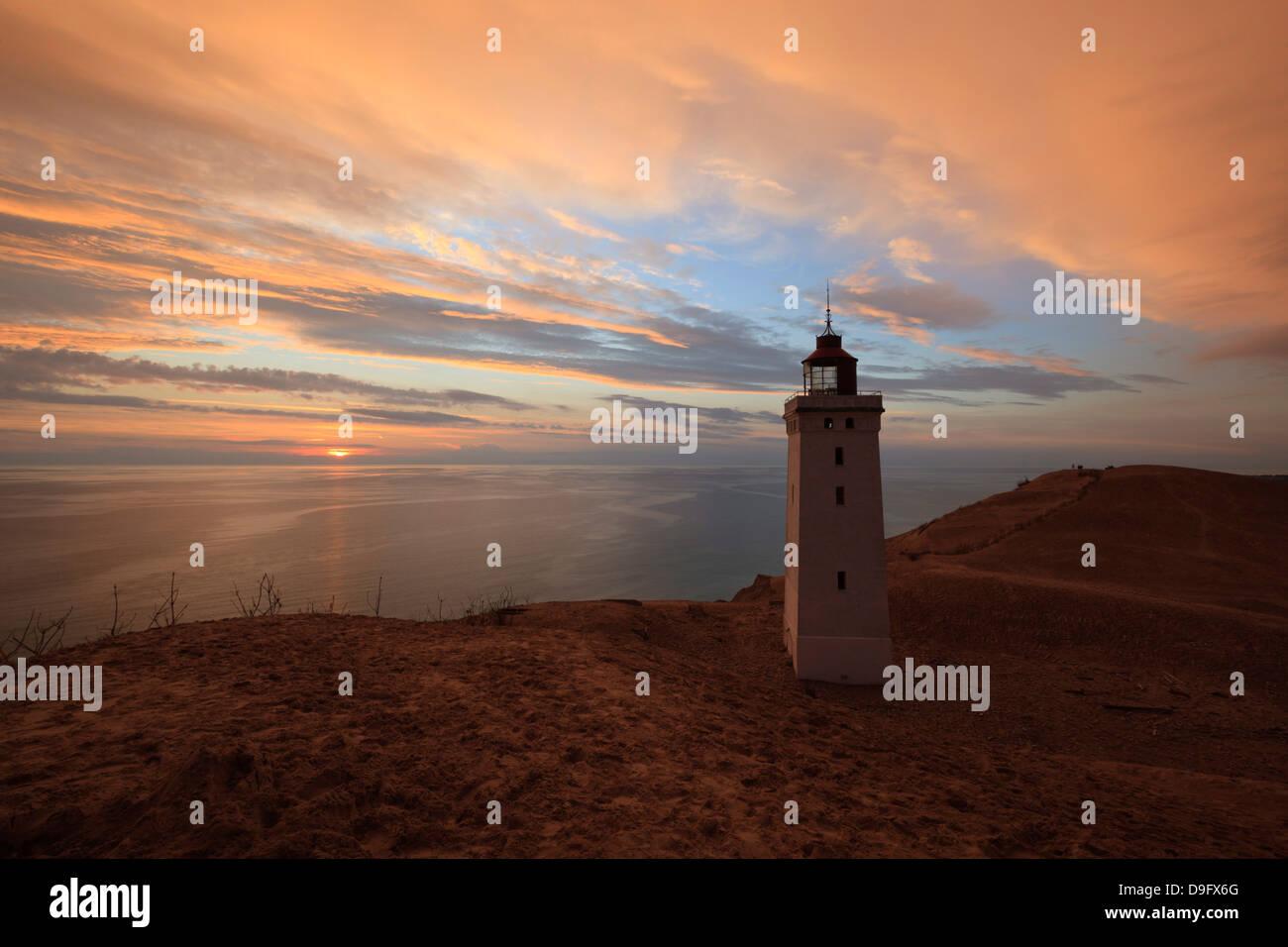 Rubjerg Knude Fyr (lighthouse) buried by sand drift at sunset, Lokken, Jutland, Denmark, Scandinavia - Stock Image