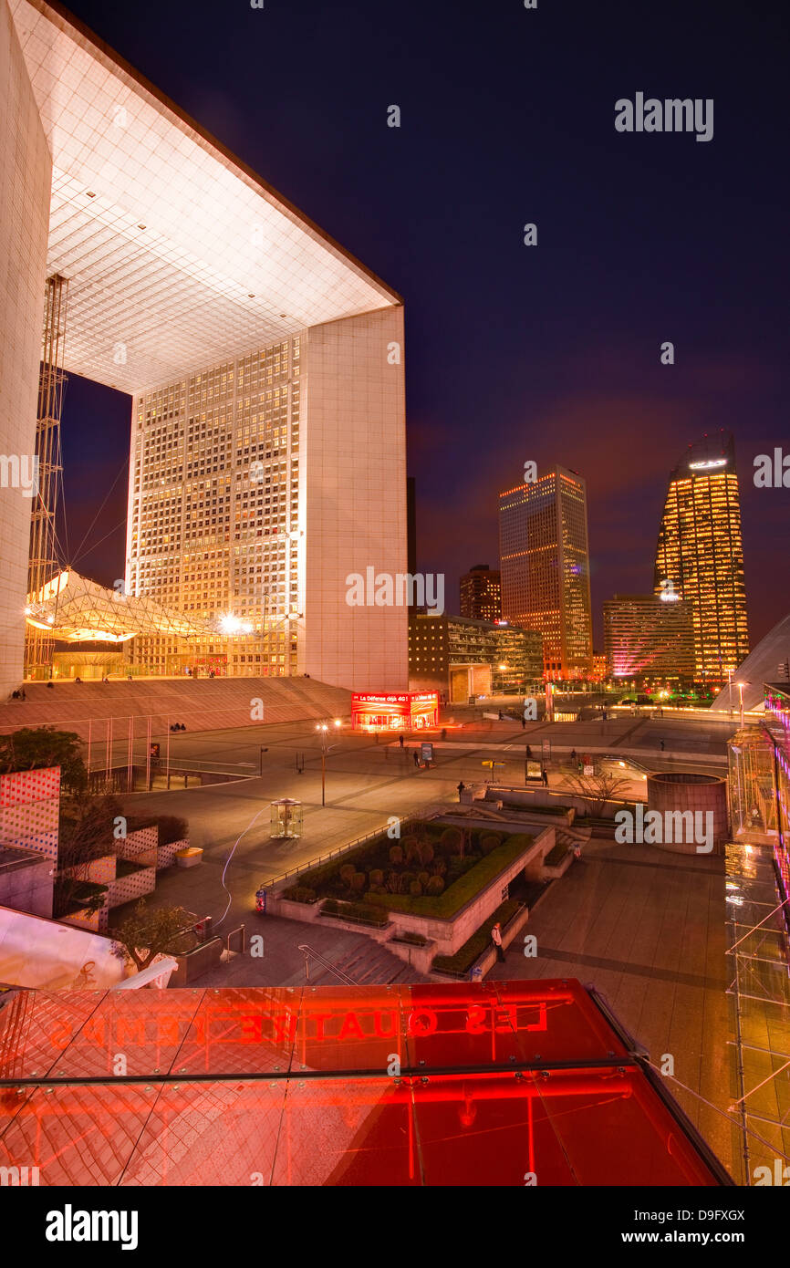 High rise office buildings and La Grande Arche in the La Defense area at night, Paris, France - Stock Image