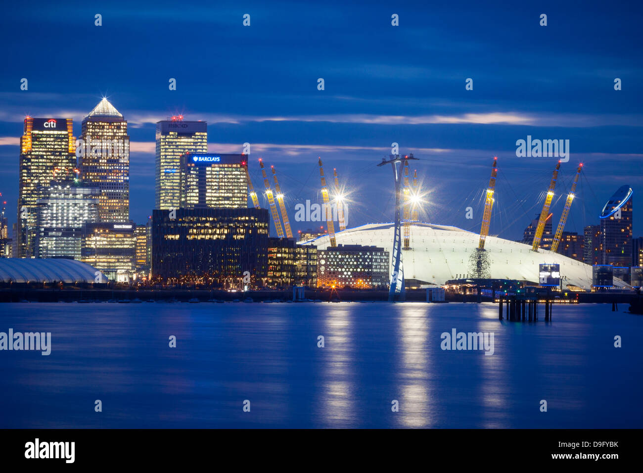 View of London skyline over the River Thames featuring Canary Wharf and O2 Arena, London, England, UK - Stock Image