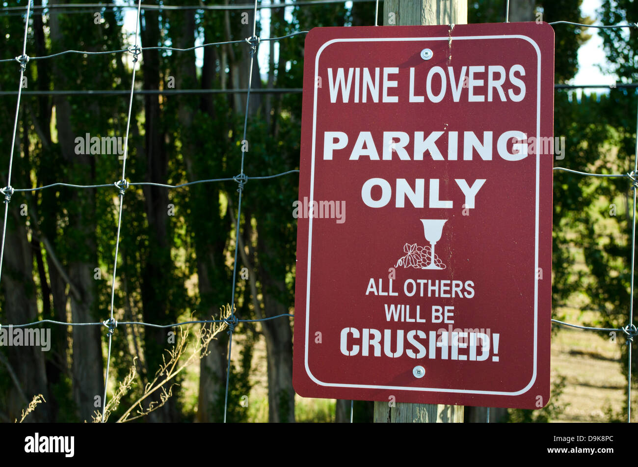 "Funny winery parking lot sign in the Okanagan area of British Columbia.  ""Wine Lovers Parking Only - All Others Stock Photo"