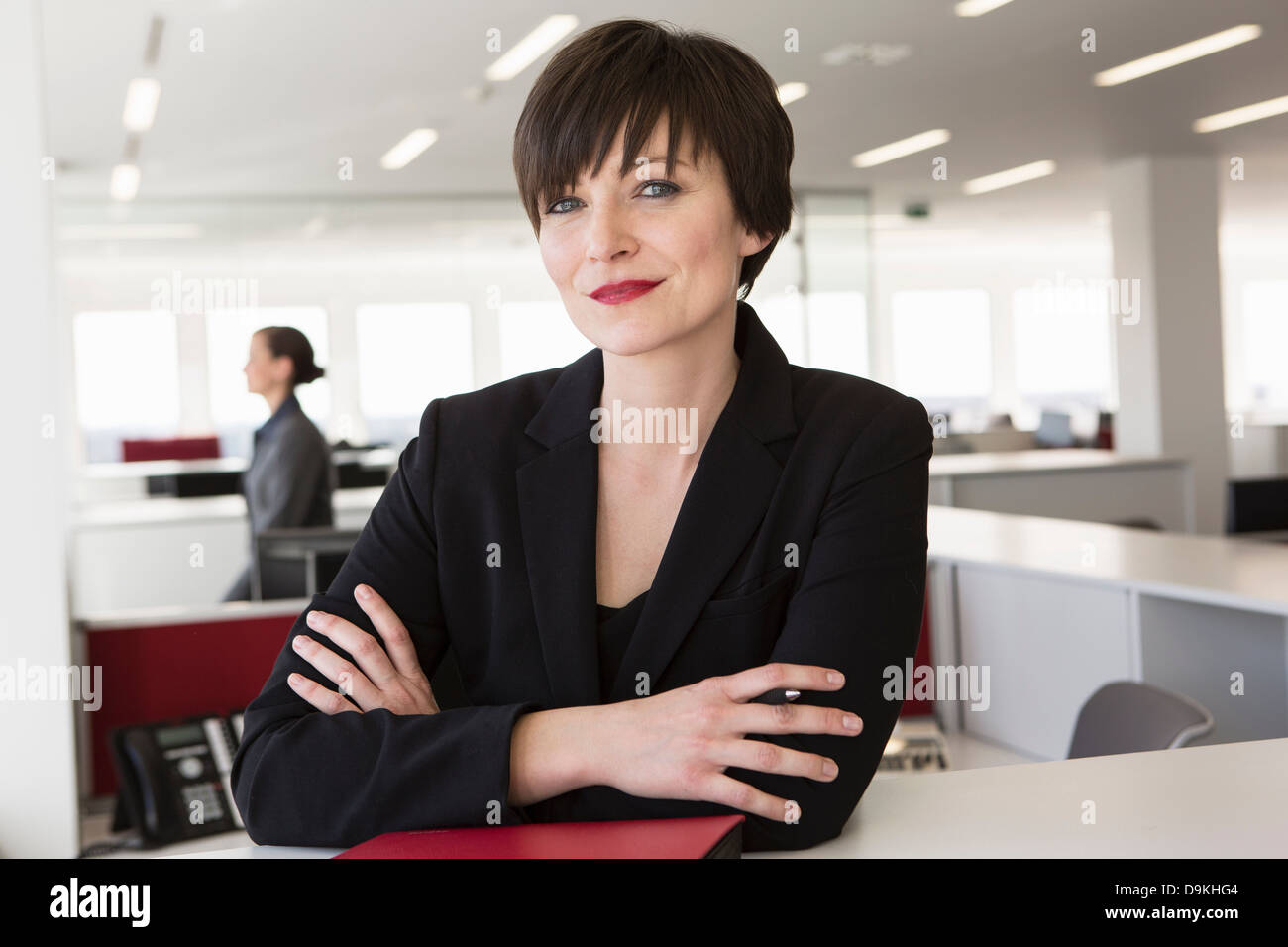 Businesswoman with arms folded - Stock Image
