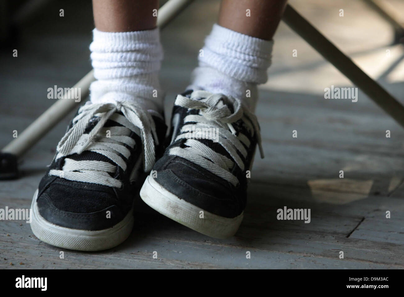 Child Kid Feet Only Wearing Black And White Sneakers Shoes