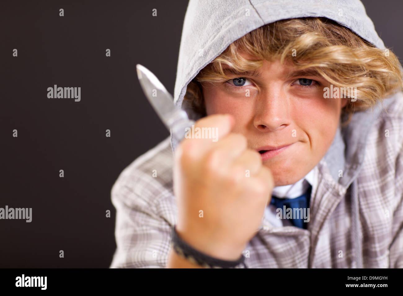 violent teen boy holding a knife - Stock Image
