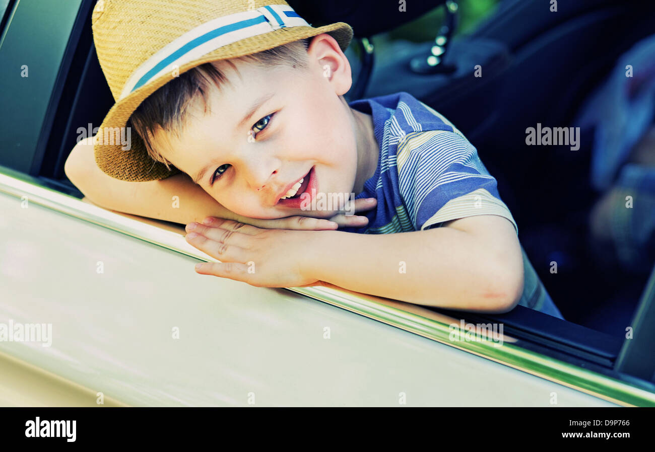 Cute little boy bored in the car - Stock Image