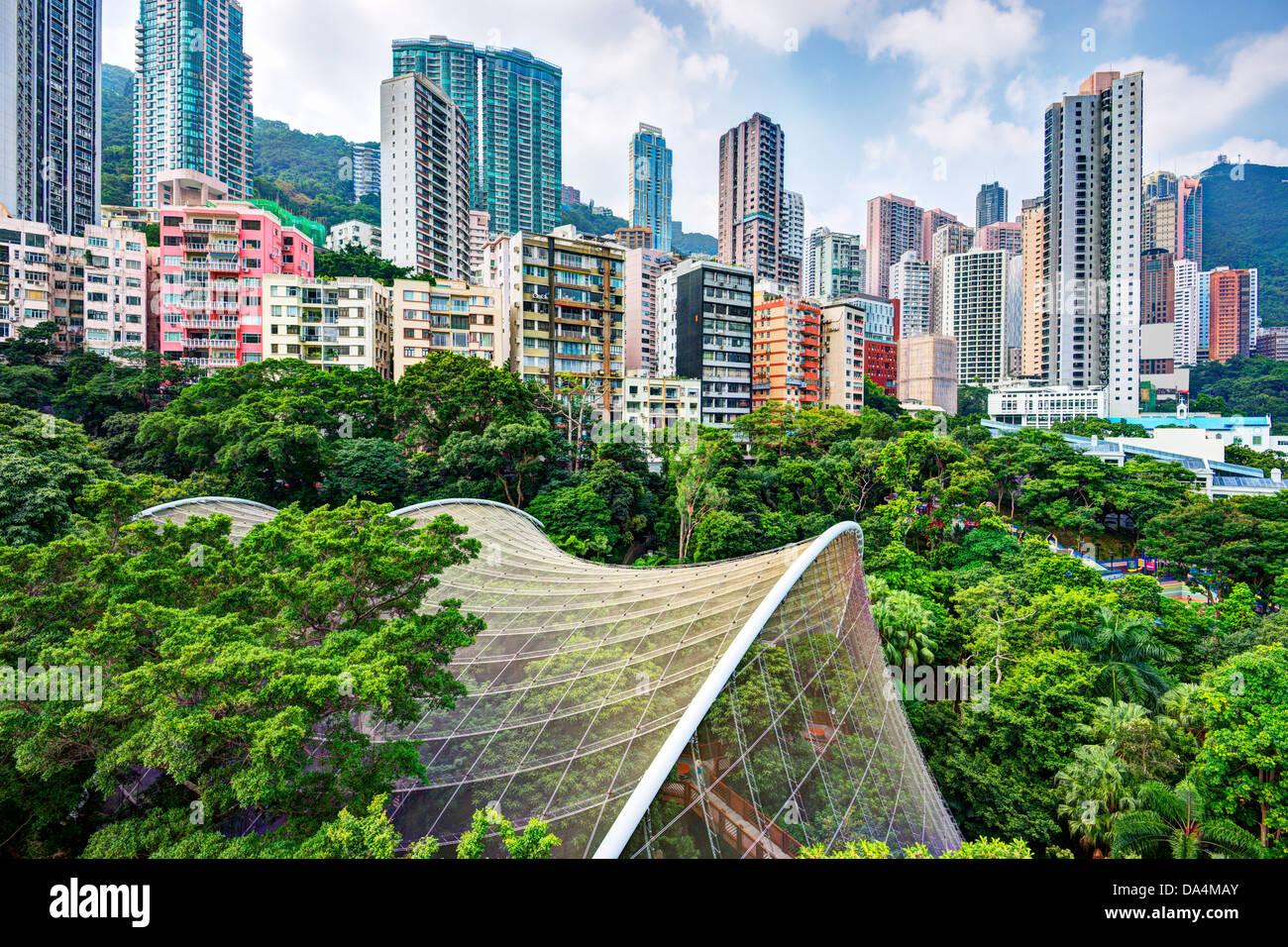 High rise apartments above Hong Kong Park and aviary in Hong Kong, China. - Stock Image