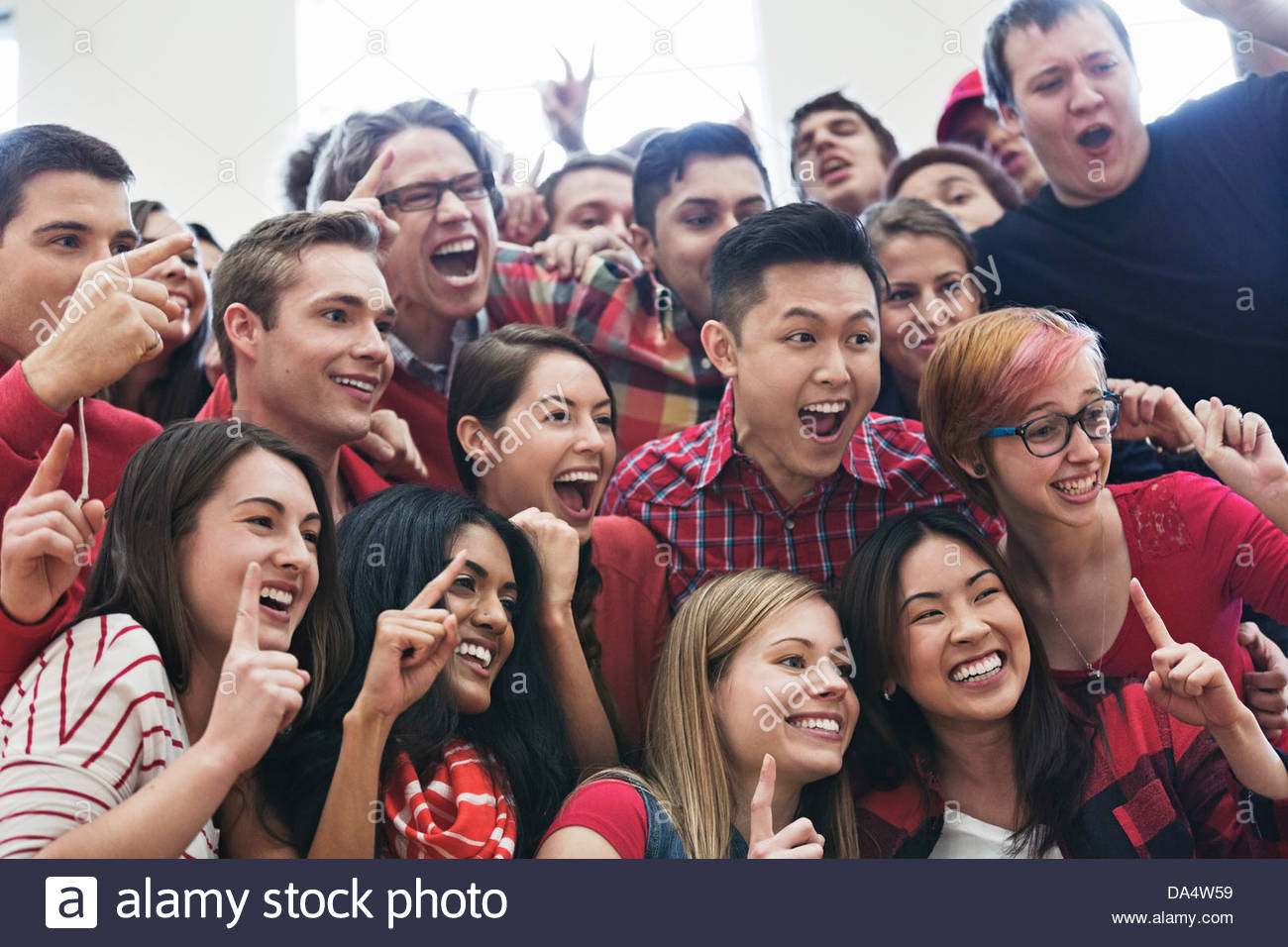 Large group of students posing for picture at college sporting event - Stock Image