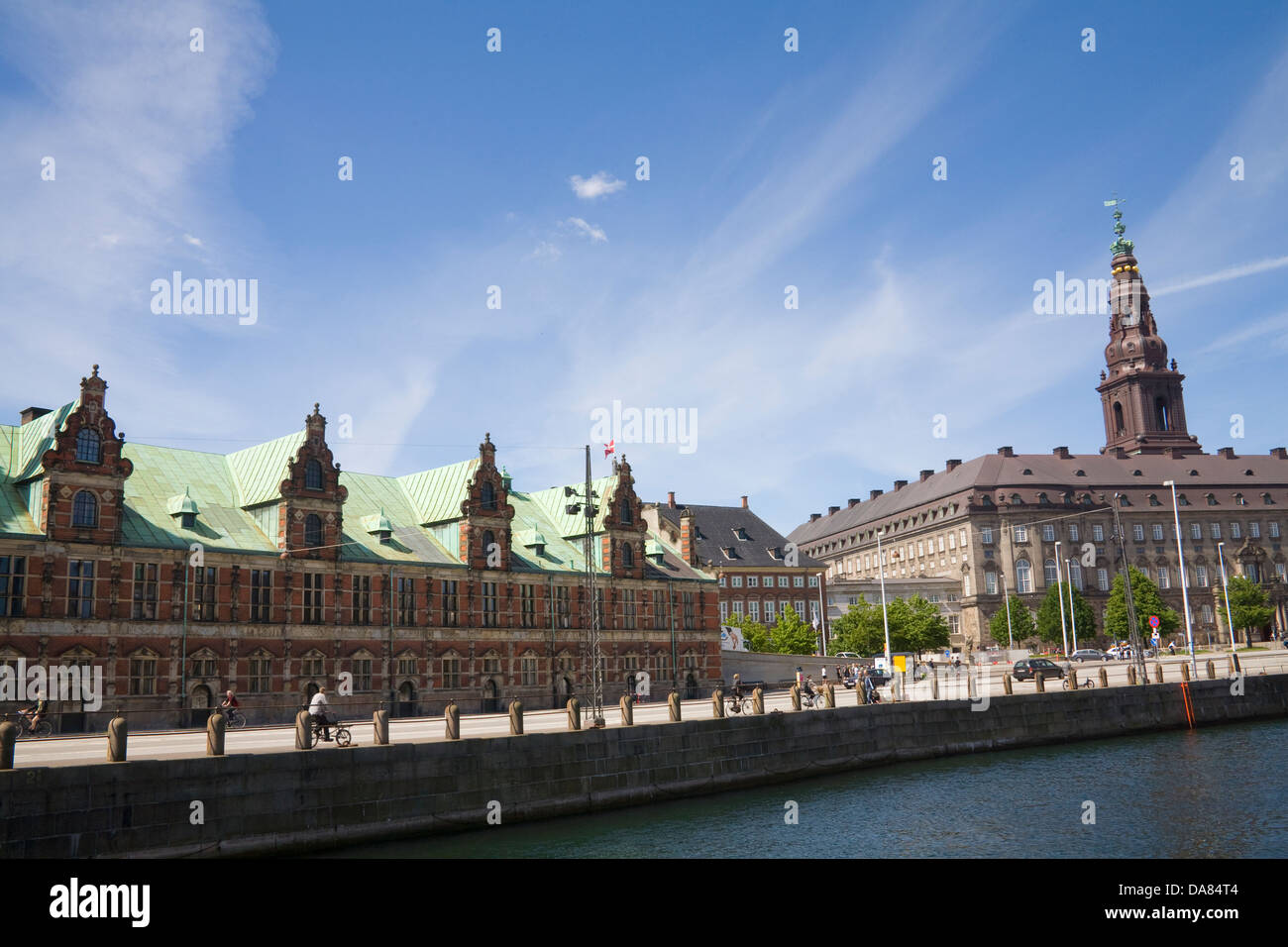 Copenhagen Denmark EU View across canal to Old Stock Exchange Building Borsen and Christiansborg Palace on islet - Stock Image