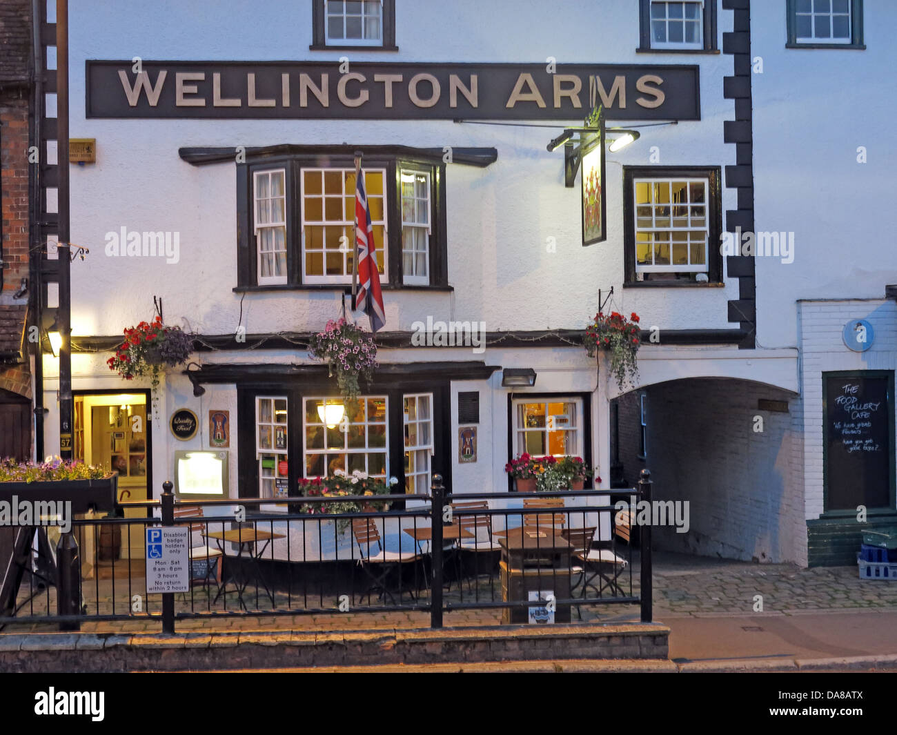 street,1HQ,at,dusk,traditional,public,house,Wiltshire,country,town,old,coaching,in,real,ale,ales,CAMRA,good,pub,guide,night,nightshot,shot,mixed,lighting,travel,tourist,tourism,bar,boozer,alehouse,SN81HQ,Food,Service,Atmosphere,Value,Friendly local pub small quaint drinking establishment cobble,gotonysmith,cobbled,cobbles,union,jack,flag,unionflag,english,british,GB,great,Britain,traditional,county,white,and,black,faced,Uk,United,Kingdom,licensing,licencing,hours,restrictive,allday,all,day,under,threat,closing,pubco,Wellingtonarms,good,pub,guide,guides,big,wide,sign,Buy Pictures of,Buy Images Of