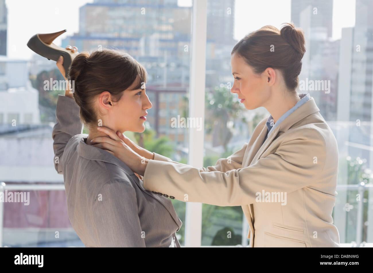 Businesswomen having a violent fight - Stock Image