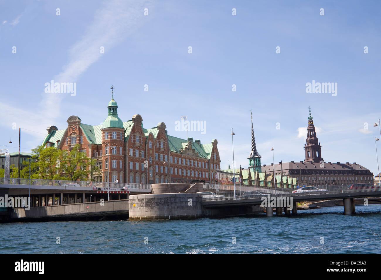 Copenhagen Denmark EU Approaching bridge over inner harbour with view of Old Stock Exchange Spiral tower Christiansborg - Stock Image