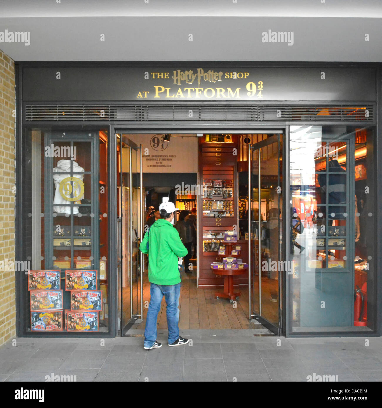 Harry Potter shop at platform nine and three quarters within Kings Cross railway station building - Stock Image