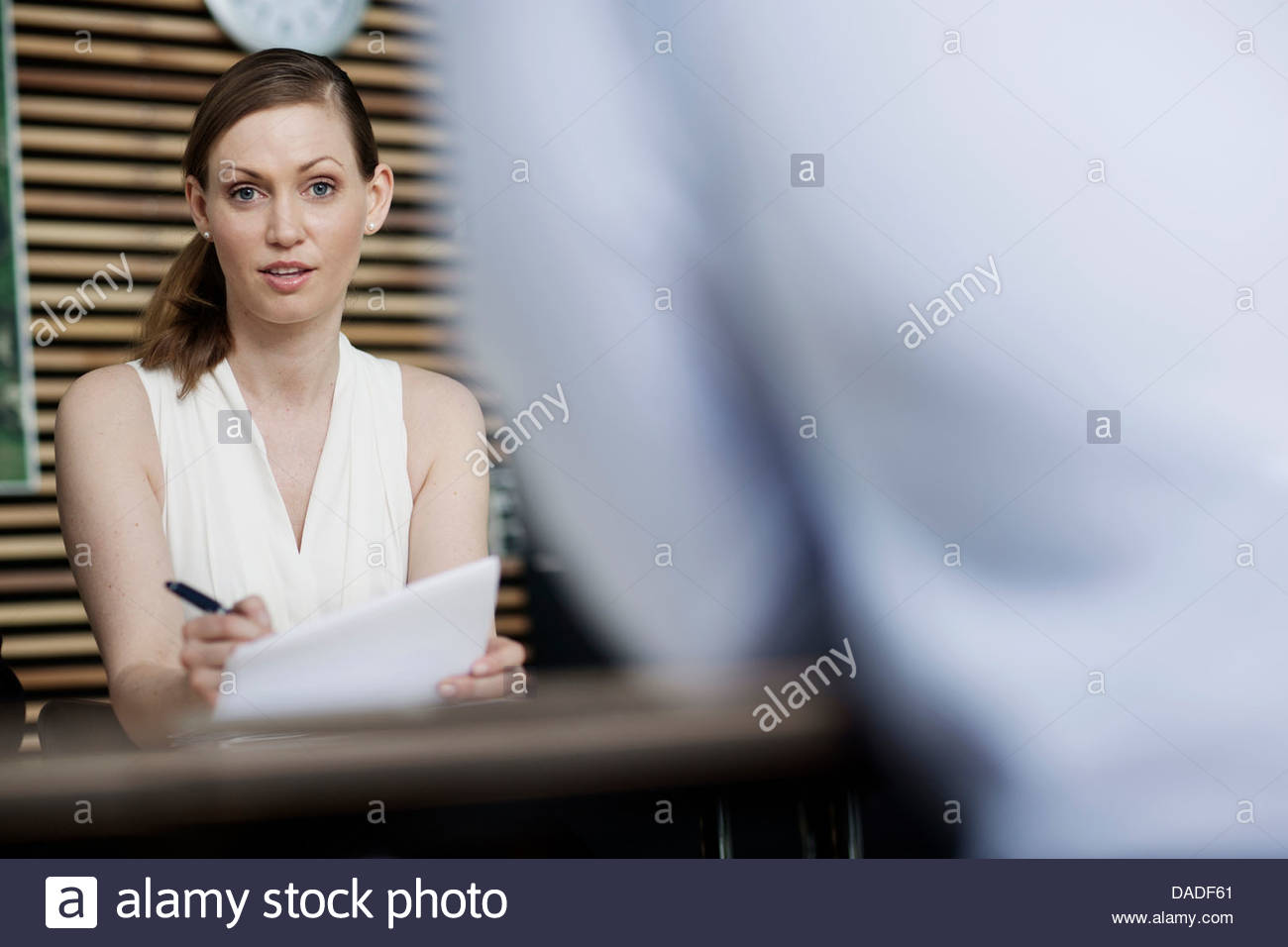 Woman looking at camera - Stock Image